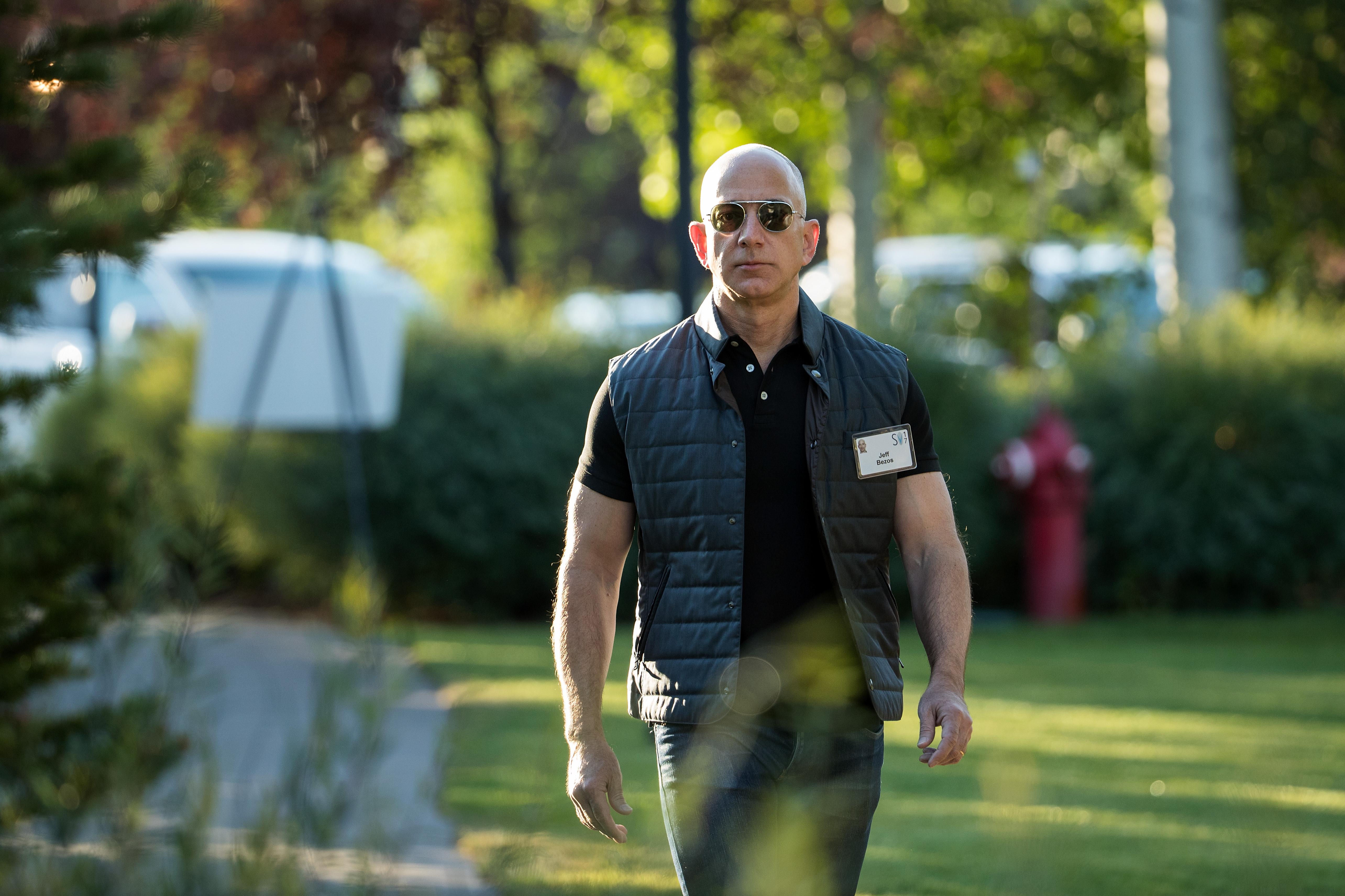 Jeff Bezos walks outside in Sun Valley, Idaho, in 2017.