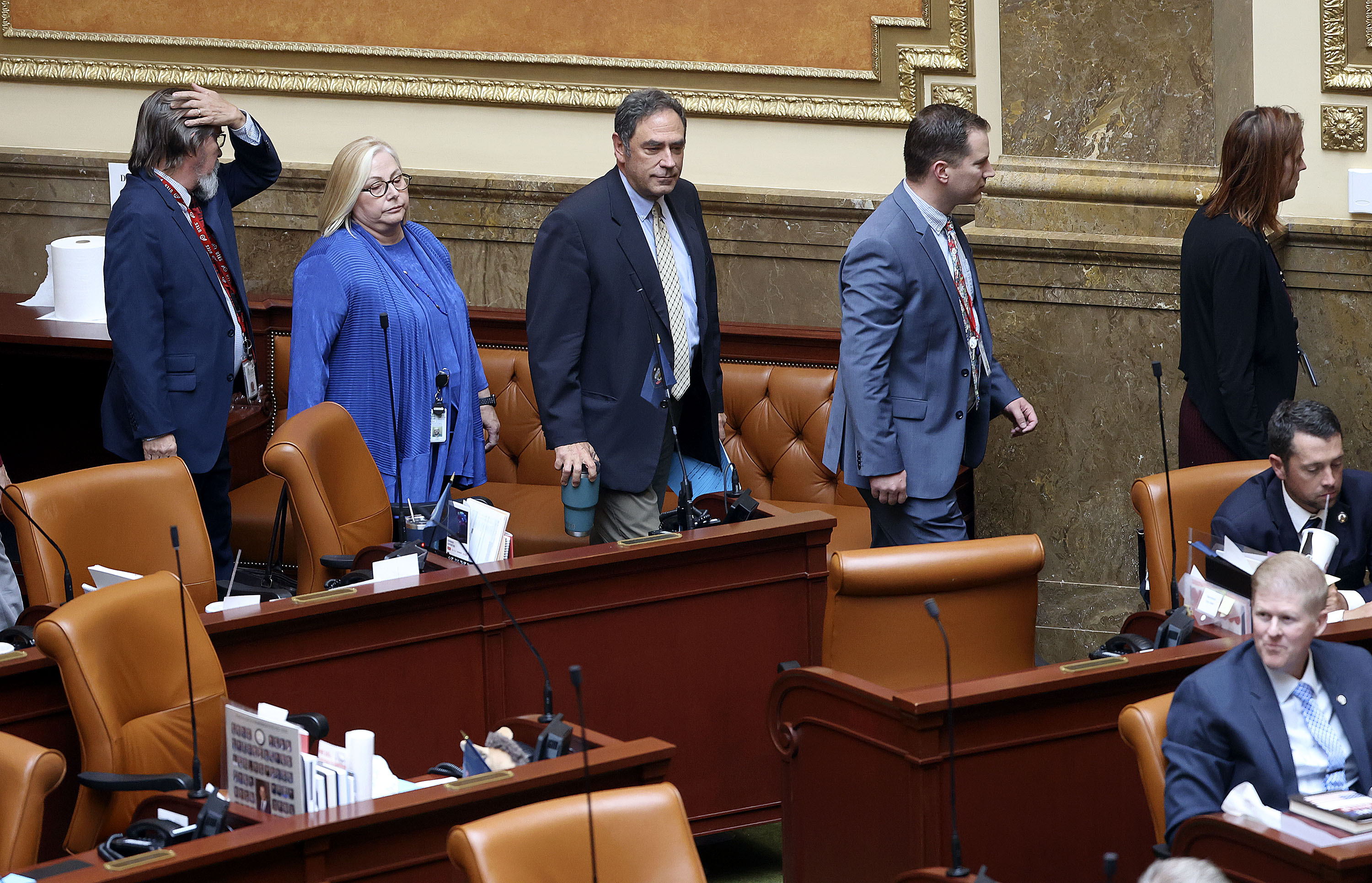 Democratic lawmakers walk out of an extraordinary session of the Legislature in protest of Republican lawmakers' plans to pass resolutions encouraging a ban of critical race theory concepts in Salt Lake City.