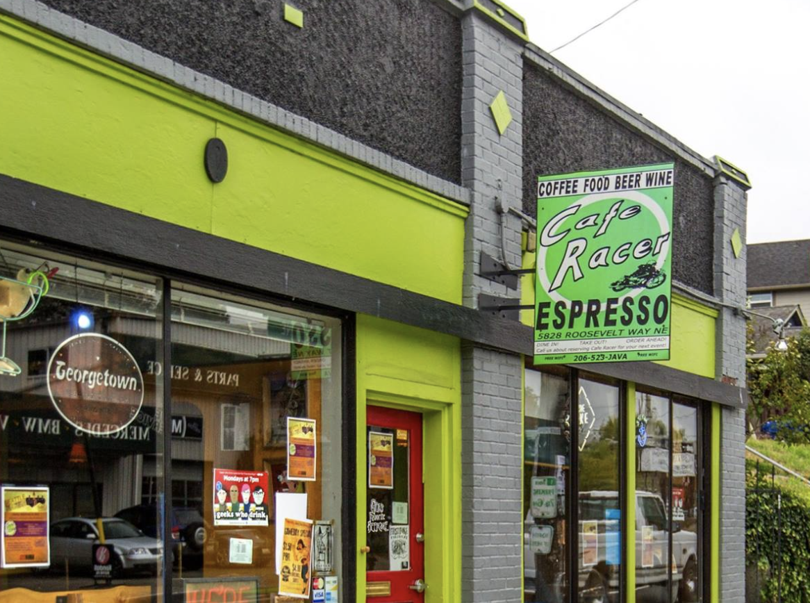 Cafe Racer's former location on Roosevelt Way, with the shop's iconic green sign out front
