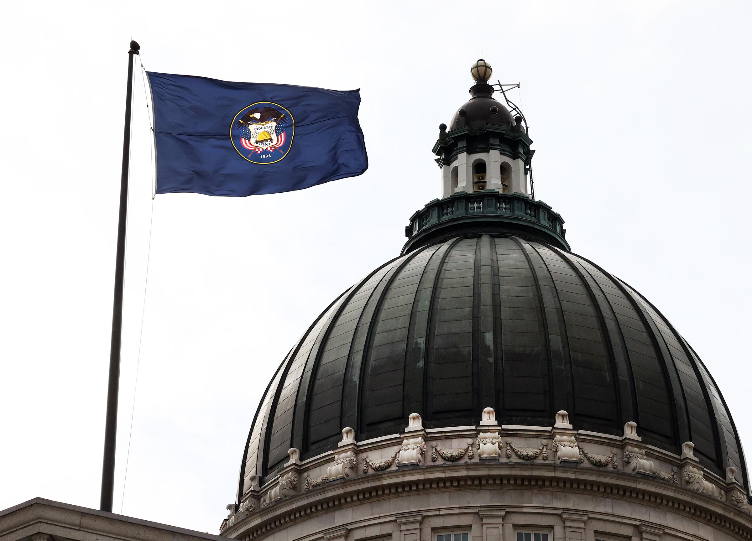 The Utah flag flies over the Capitol in Salt Lake City on Friday, Jan. 22, 2021.