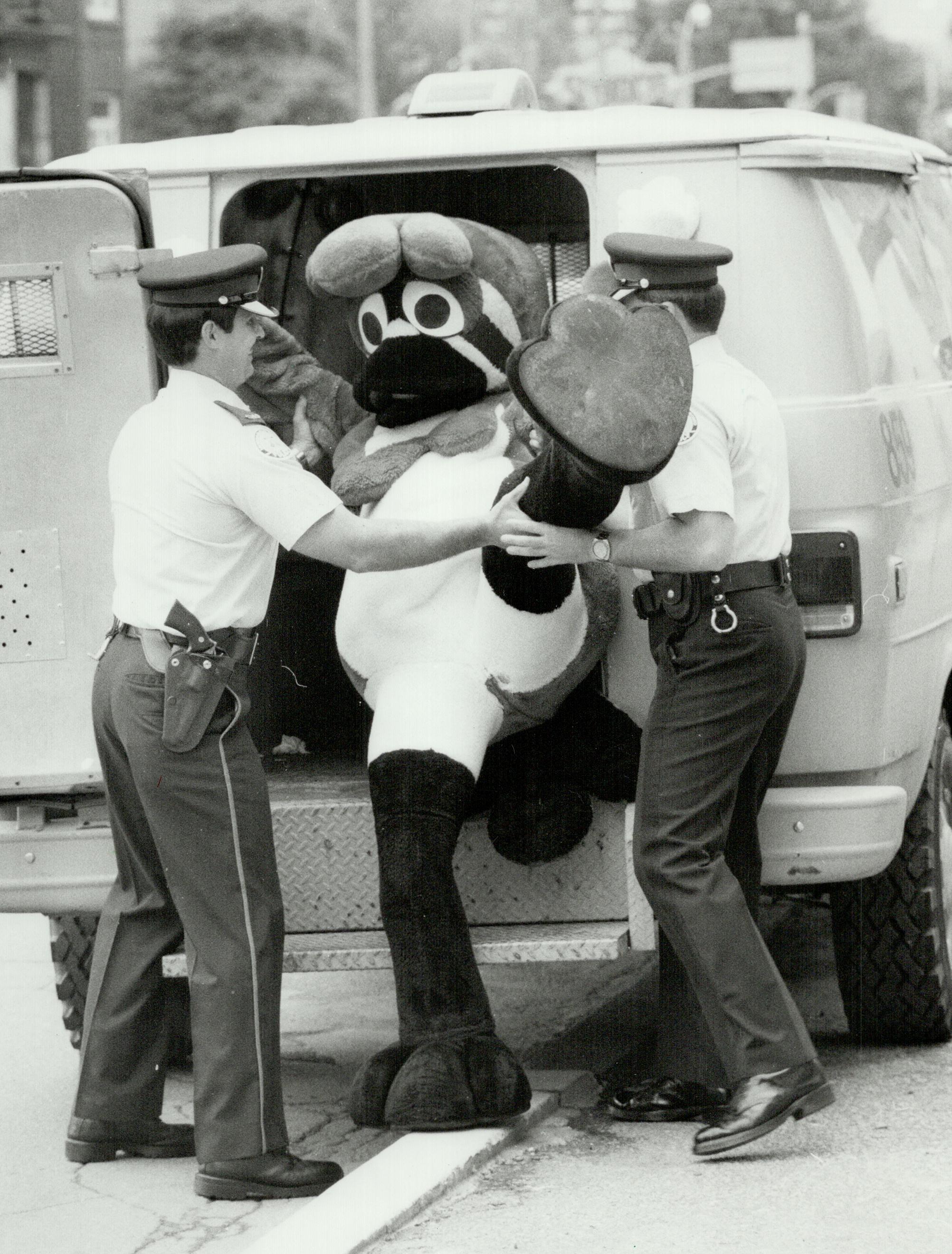 Bye bye Birdy; Blue Jays mascot B. . Birdy is loaded into a police wagon by officers Doug Walker, le