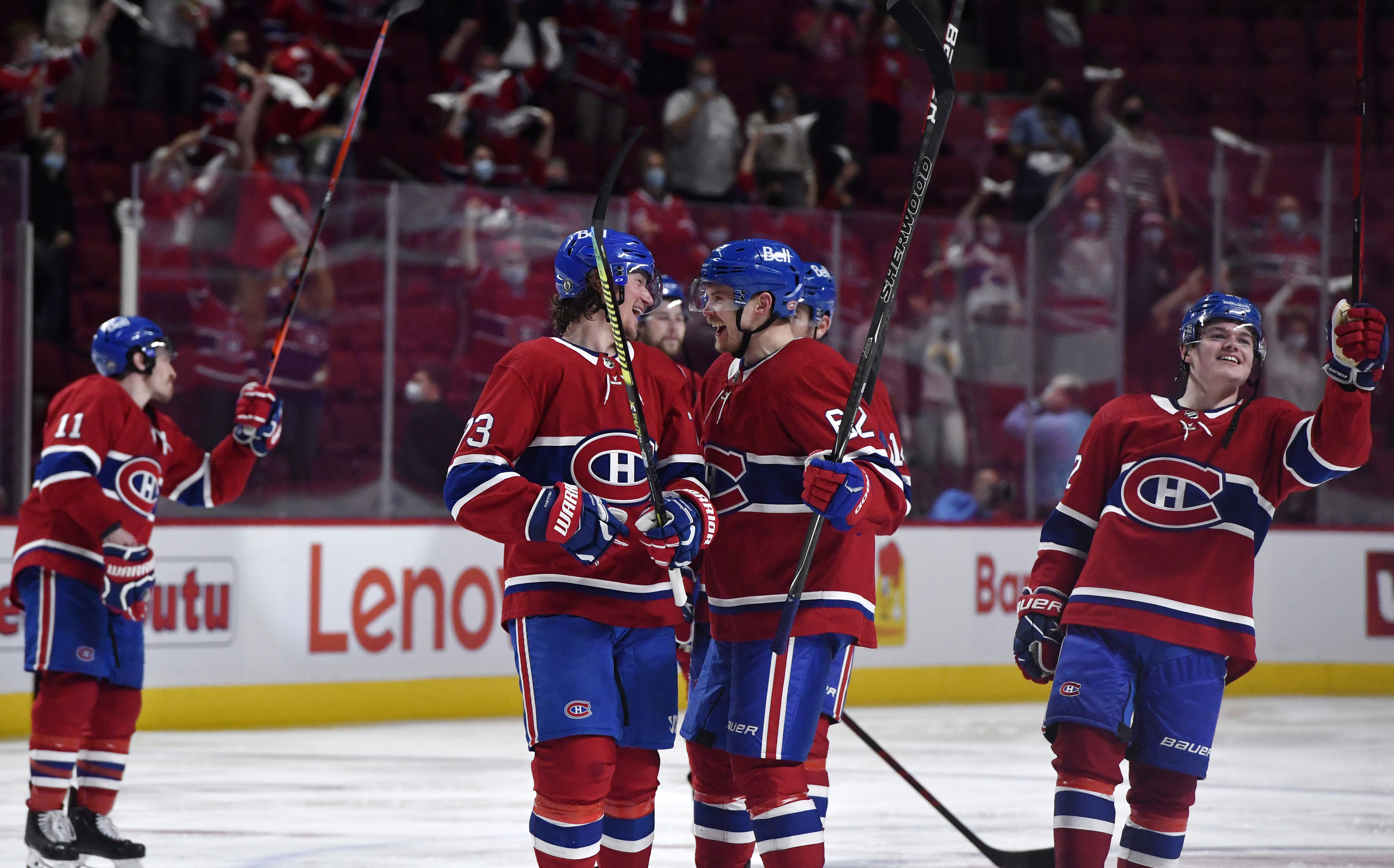 Montreal Canadiens forward Tyler Toffoli (73) and teammate forward Artturi Lehkonen (62) celebrate the series win against the Winnipeg Jets during the overtime period in game four of the second round of the 2021 Stanley Cup Playoffs at the Bell Centre.
