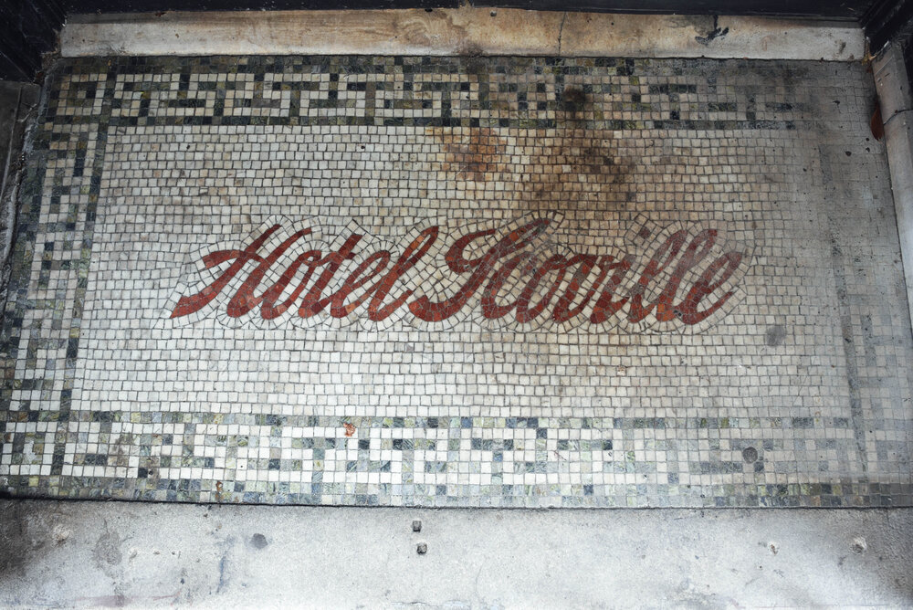 The old tiled floor entrance to Hotel Scoville on Mitchell Street in South Downtown