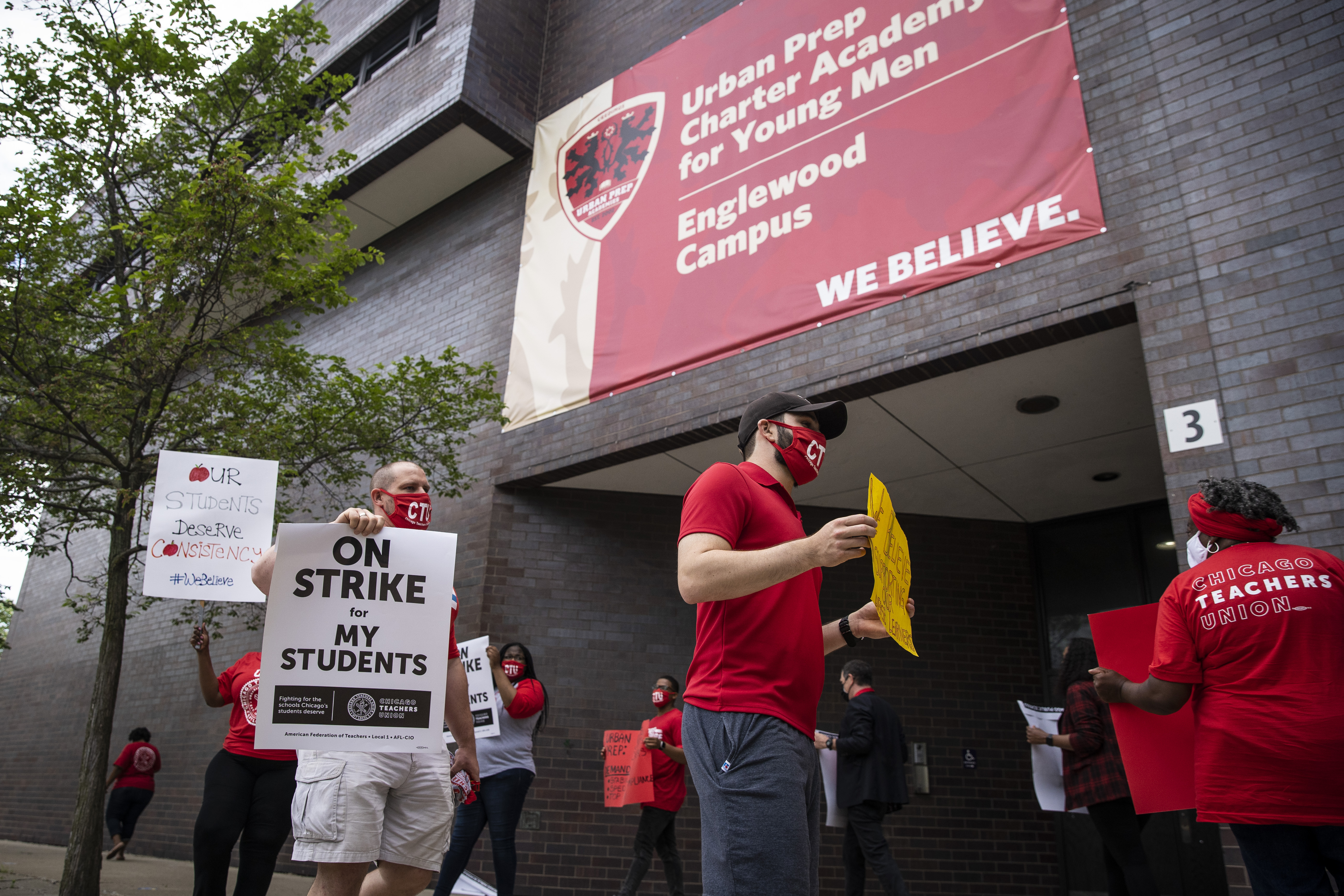 Chicago Teachers Union members and their supporters walk the picket line outside Urban Prep Charter Academy For Young Men - Englewood Campus at 6201 S. Stewart Ave., Tuesday morning, June 8, 2021.
