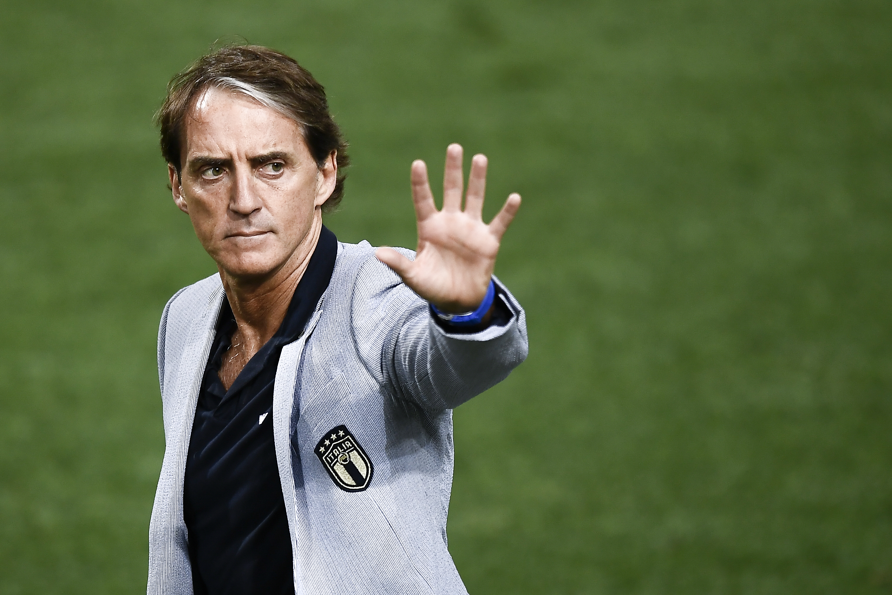 Roberto Mancini, head coach of Italy, greets the fans at the...