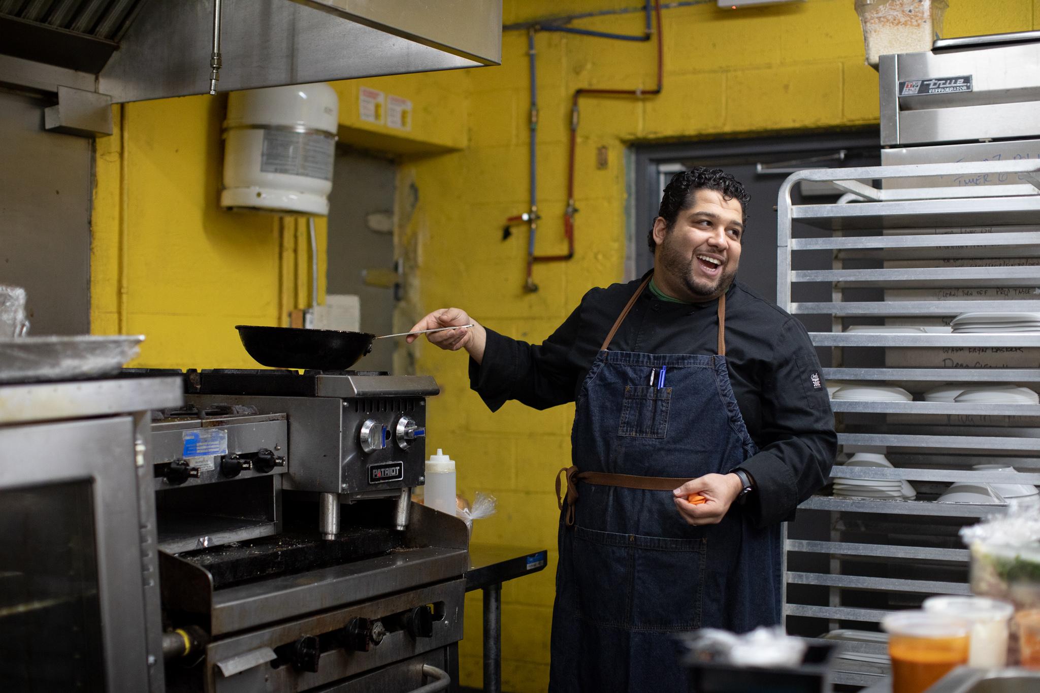 Chef Omar Anani prepares food in his kitchen at Saffron De Twah.