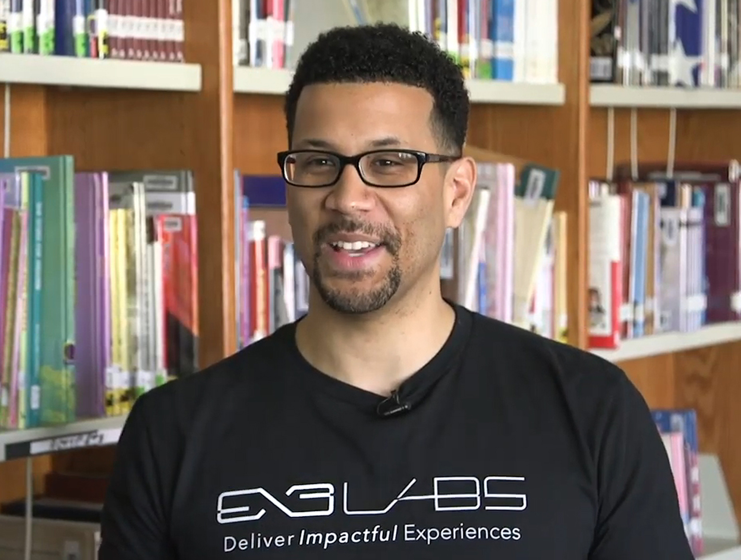 Adam Wisniewski is shown in a company video discussing the dedication in May 2019 of an immersive learning lab at Daniel Boone Elementary School, 6710 N. Washtenaw Ave.