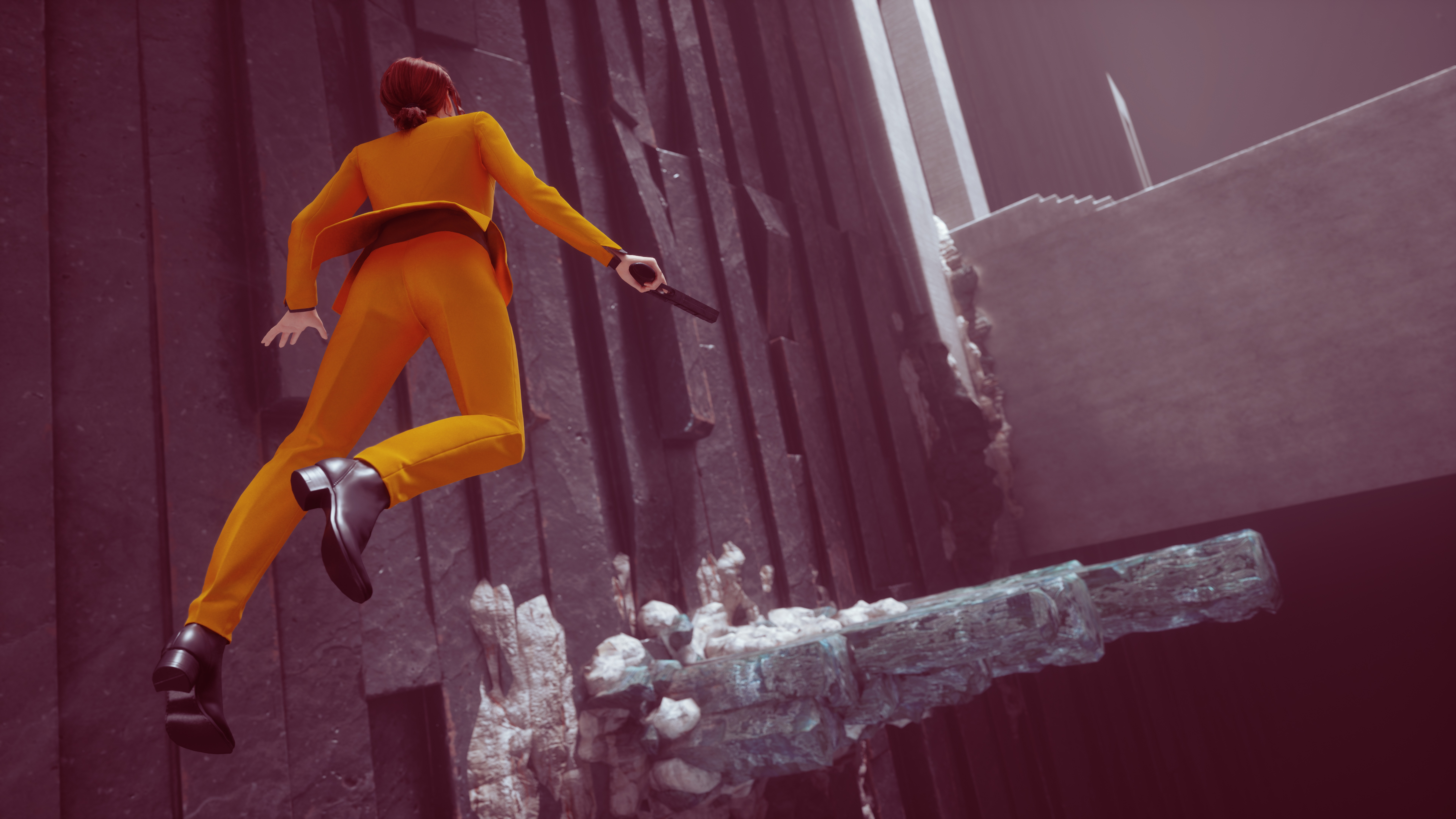 a woman in an orange jumpsuit floats through the air in Control