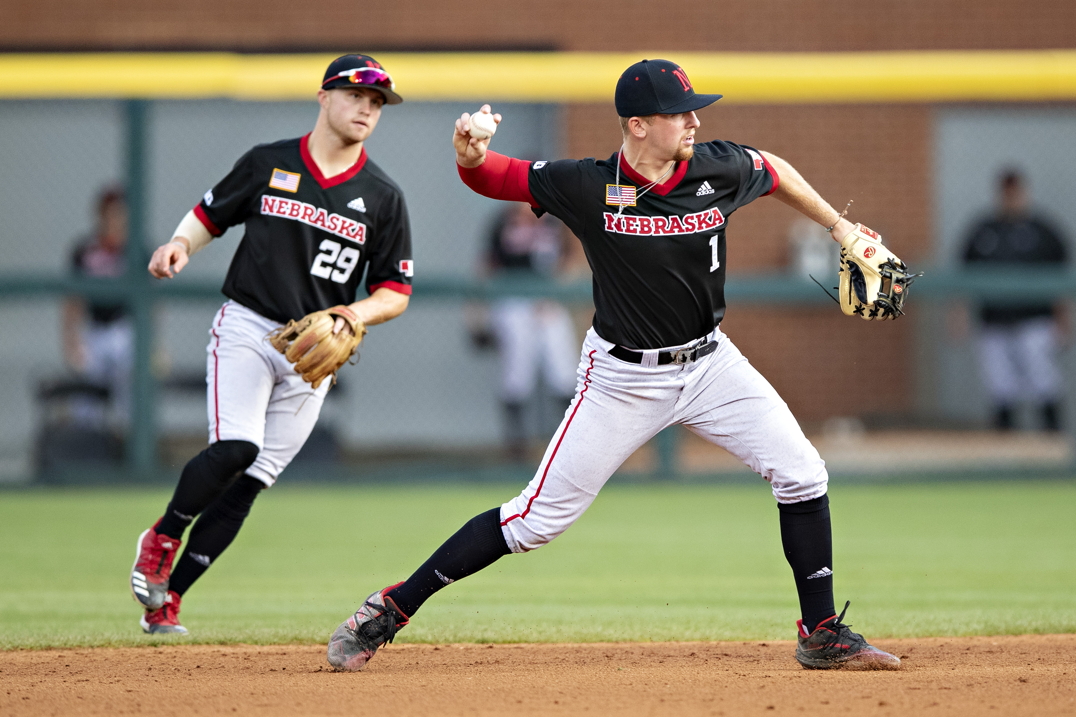 Spencer Schwellenbach of the Nebraska Cornhuskers throws out a runner at first base during a game against the Arkansas Razorbacks at the NCAA Fayetteville Regional at Baum-Walker Stadium at George Cole Field on June 7, 2021 in Fayetteville, Arkansas.