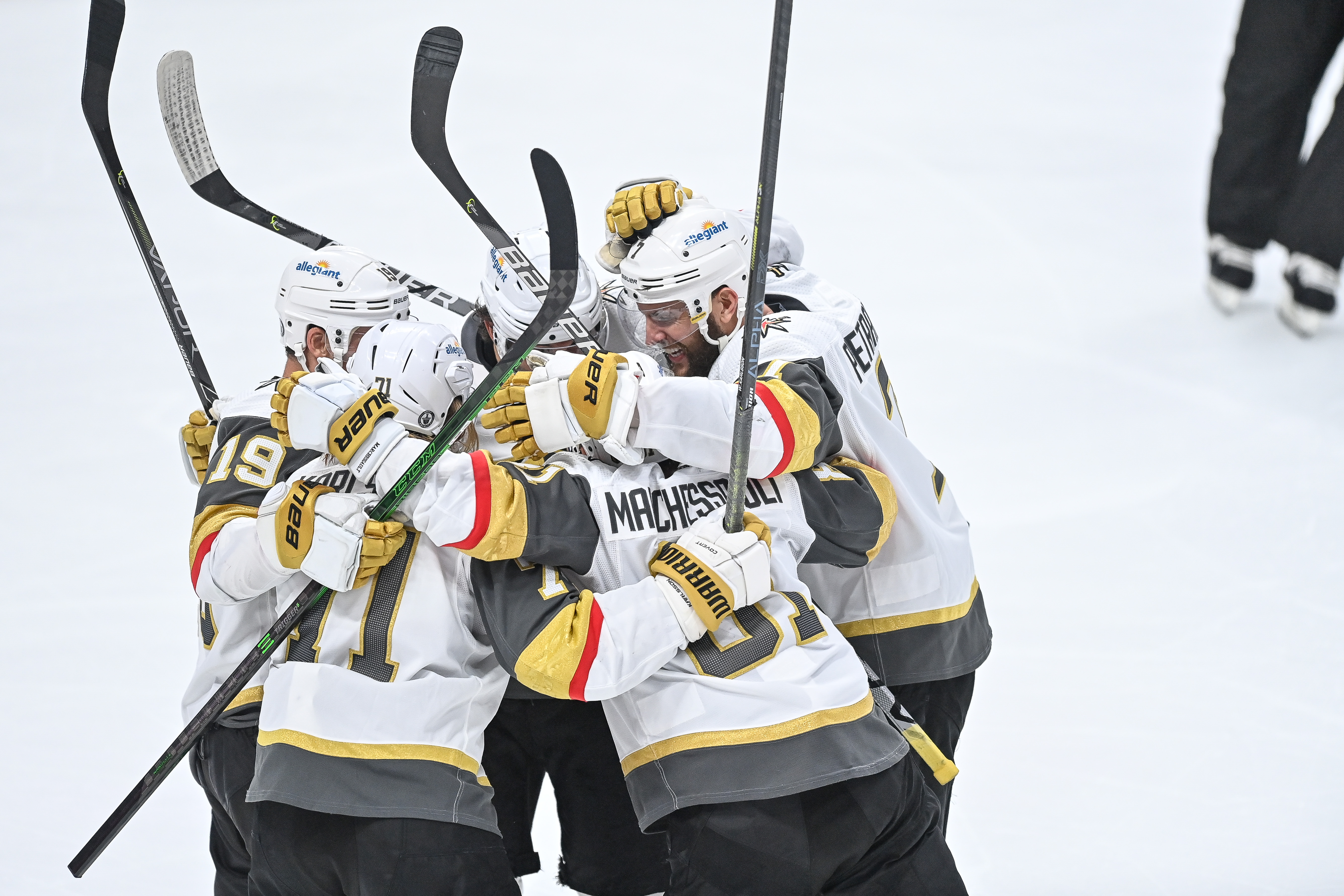 Vegas Golden Knights center Jonathan Marchessault (81), right wing Reilly Smith (19) and defenseman Alec Martinez (23) celebrate with center William Karlsson (71) after a third period Marchessault goal during a Stanley Cup Playoffs second round game between the Vegas Golden Knights and the Colorado Avalanche at Ball Arena in Denver, Colorado on June 8, 2021.