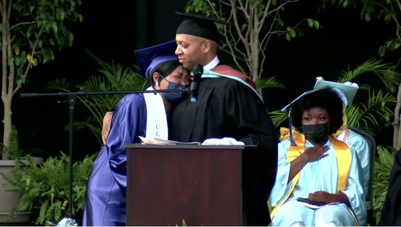 Richard Gordon, principal of Paul Robeson High School, consoles Tawanda Robinson, mother of David Williams.