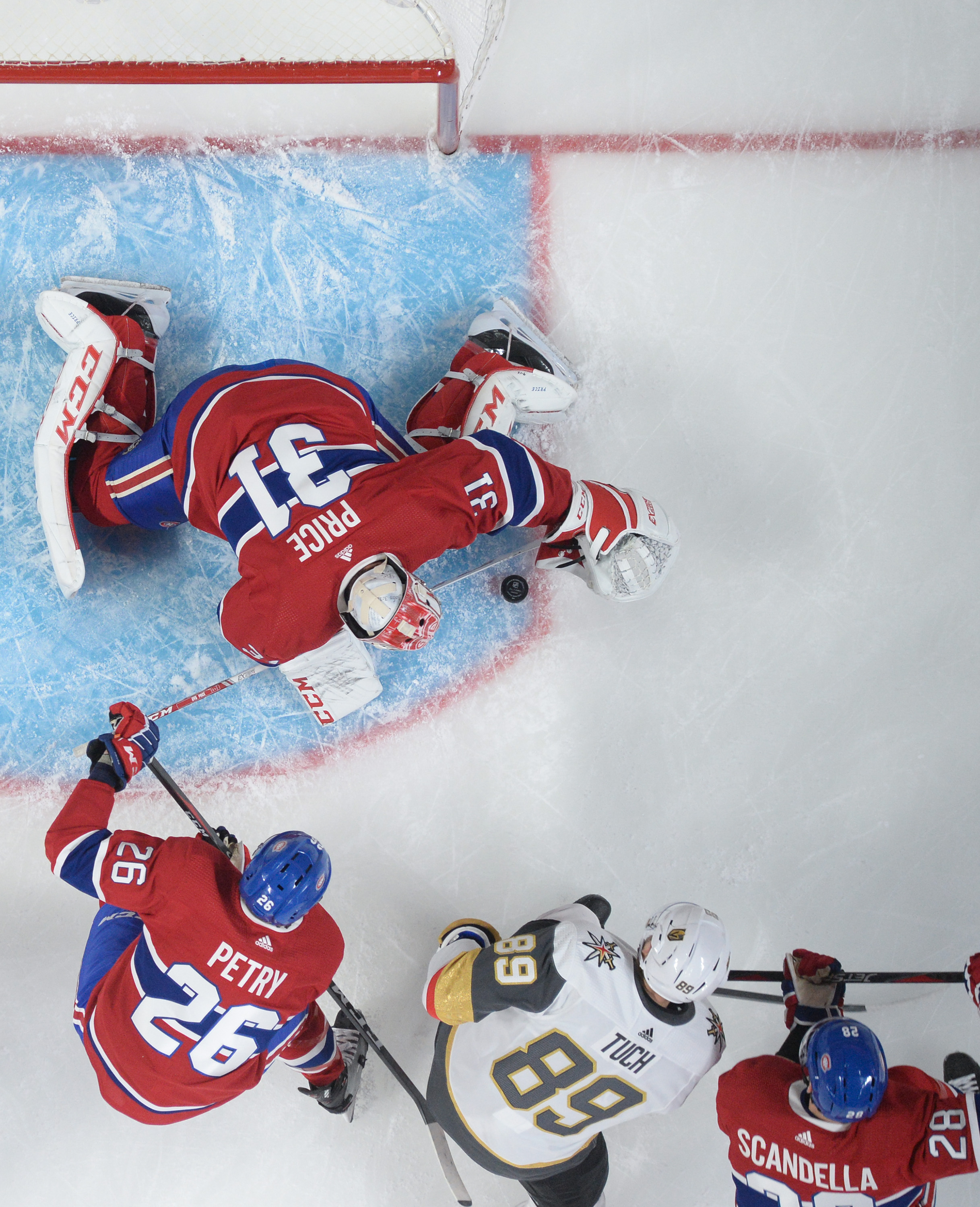 Carey Price #31 of the Montreal Canadiens defends the goal against Alex Tuch #89 of the Vegas Golden Knights in the NHL game at the Bell Centre on January 18, 2020 in Montreal, Quebec, Canada.