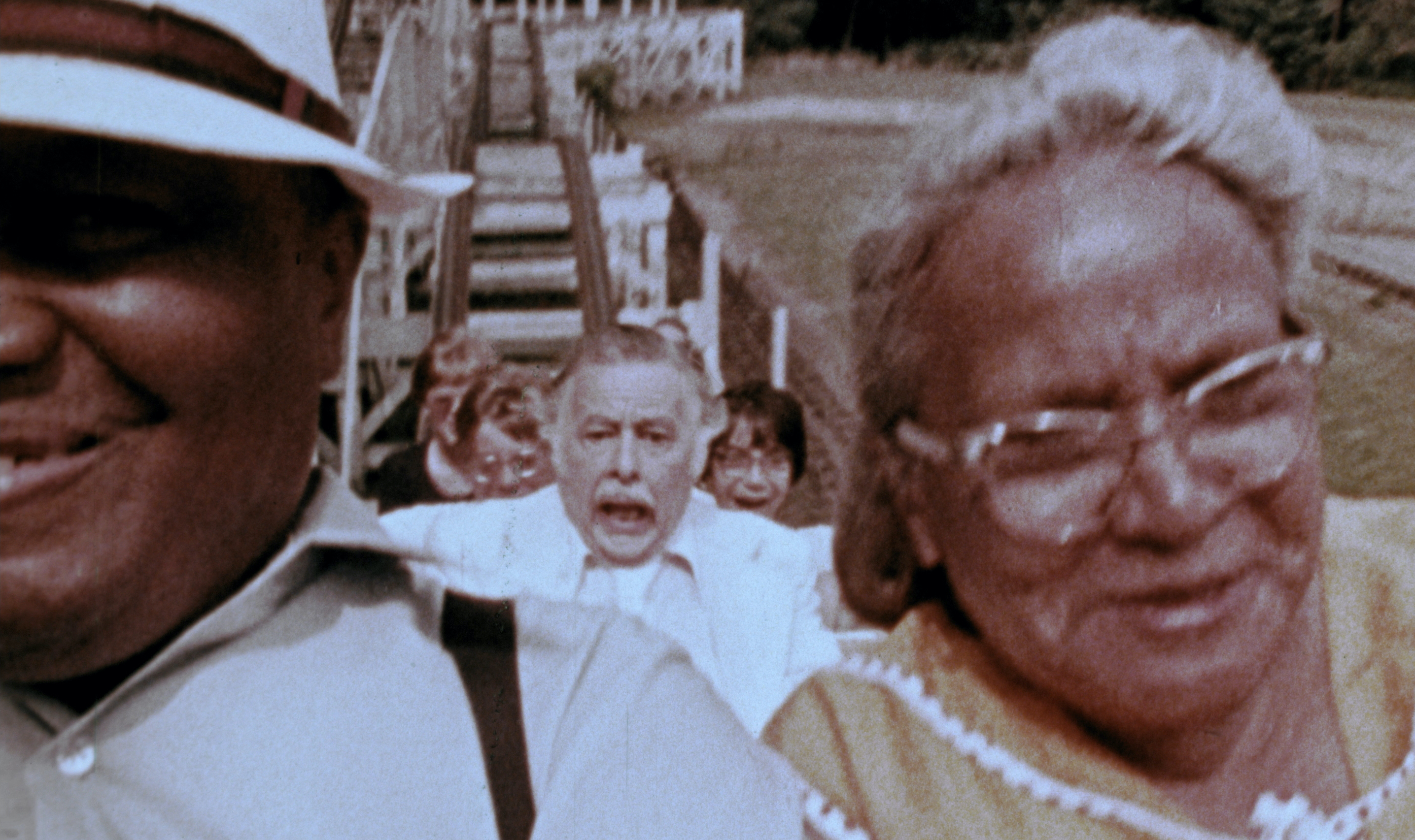 An elderly man in a black suit screams while riding a roller coaster in George A. Romero's The Amusement Park