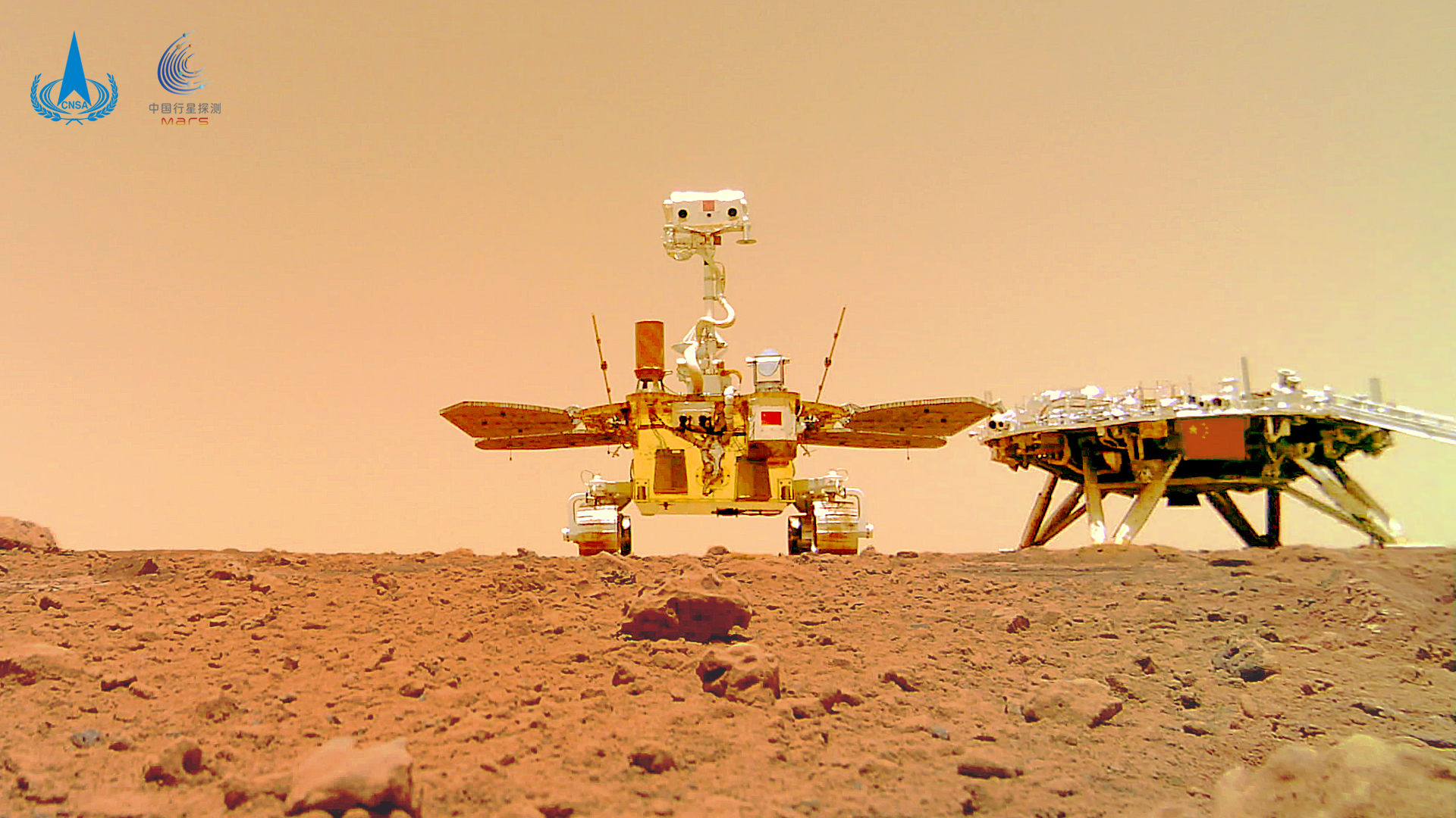 China's Zhurong rover on the surface of Mars, next to its landing platform.