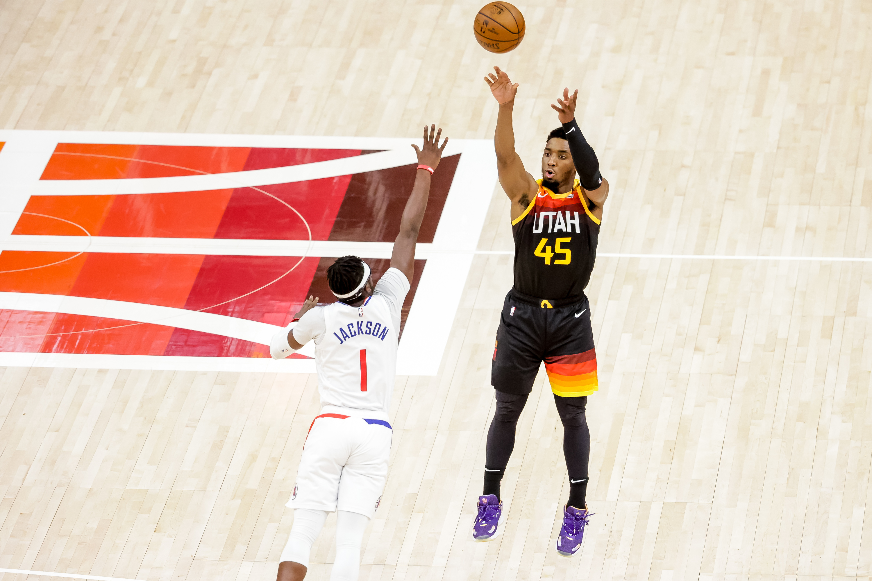 Utah Jazz guard Donovan Mitchell (45) shoots over LA Clippers guard Reggie Jackson (1) during Game 1 of the Western Conference semifinals at Vivint Smart Home Arena in Salt Lake City on Tuesday, June 8, 2021.
