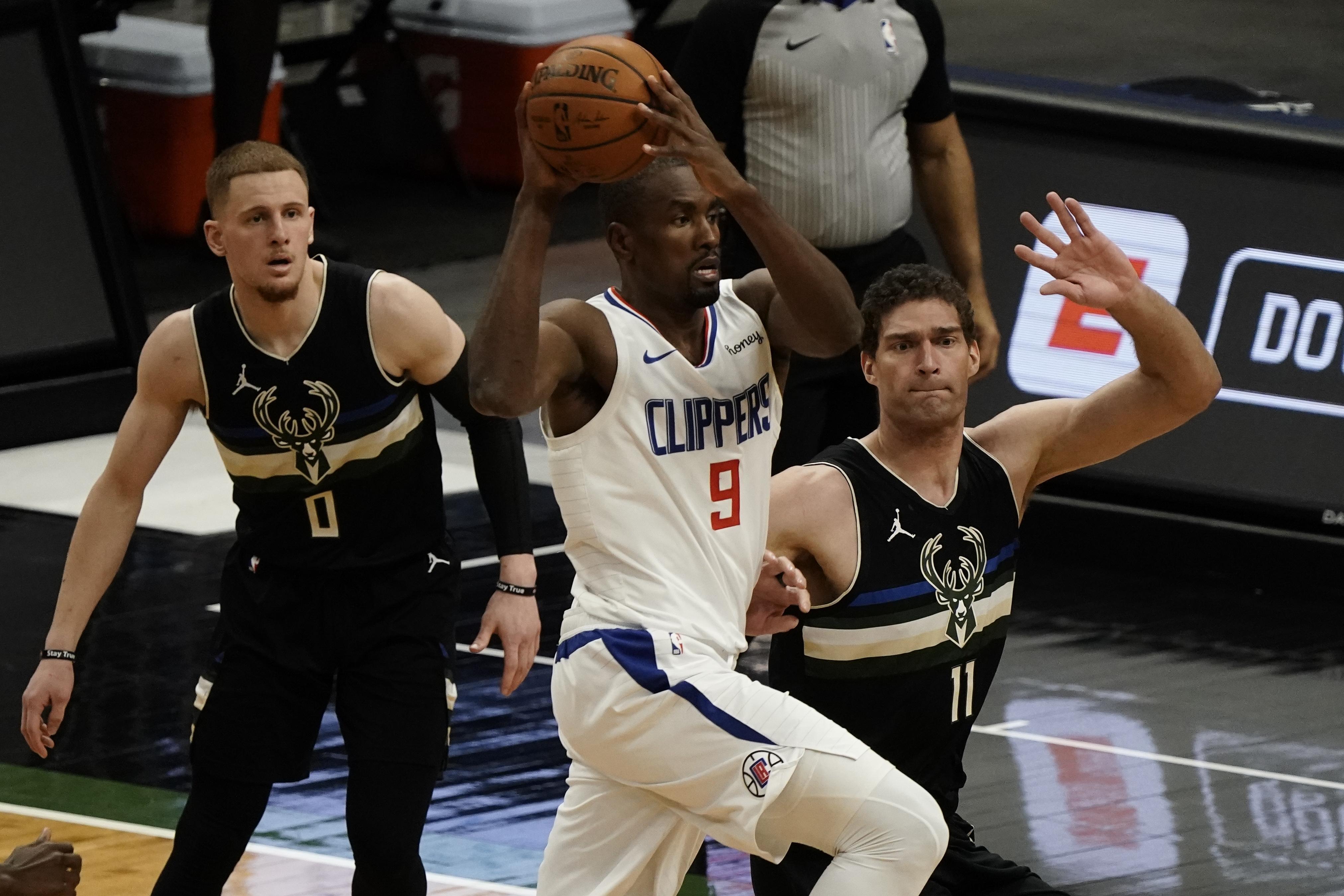 LA Clippers' Serge Ibaka drives past Milwaukee Bucks' Brook Lopez