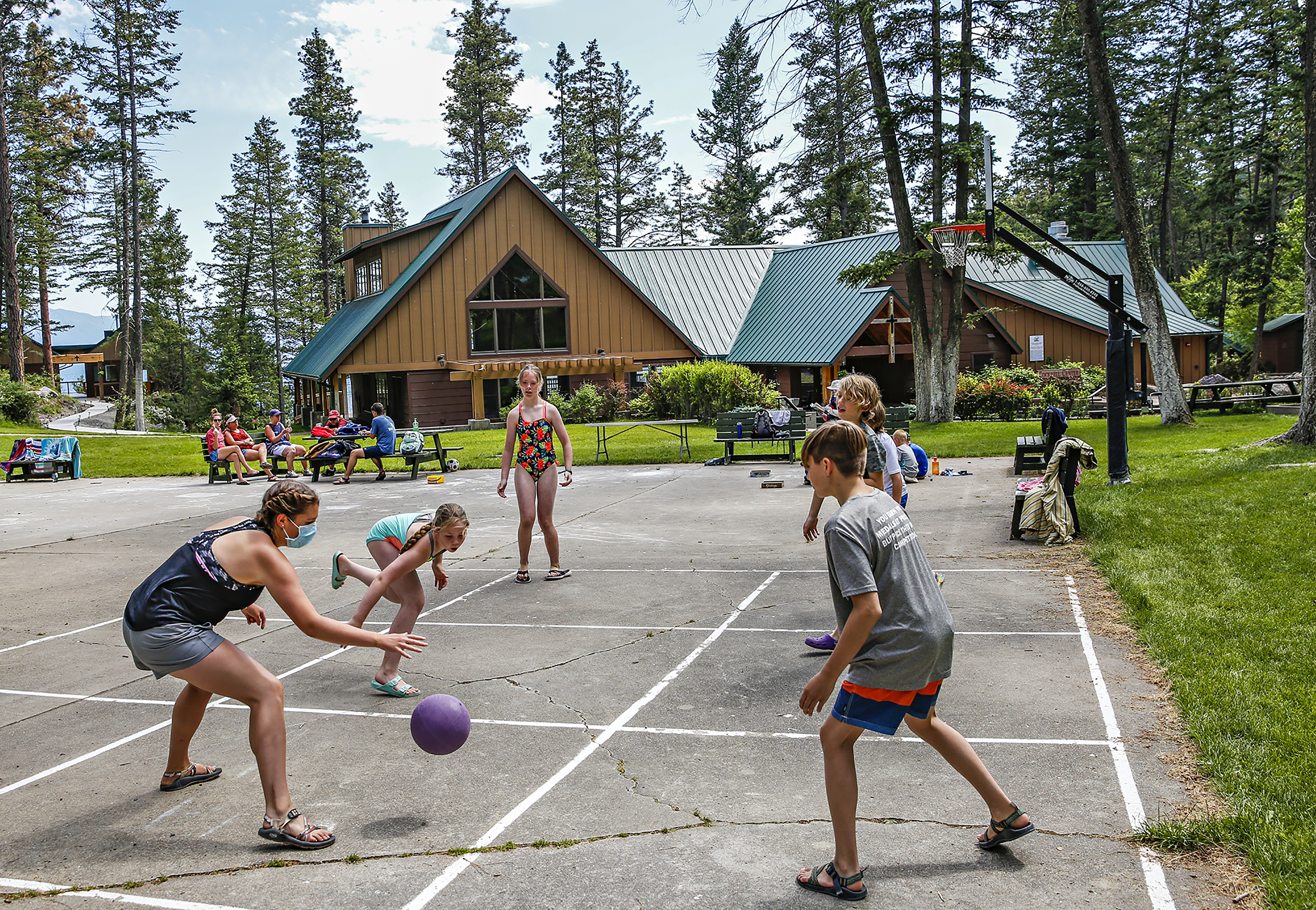 Children play on a court at Flathead Lutheran Bible Camp in Montana. Summer camp costs is an increasingly tough issue.