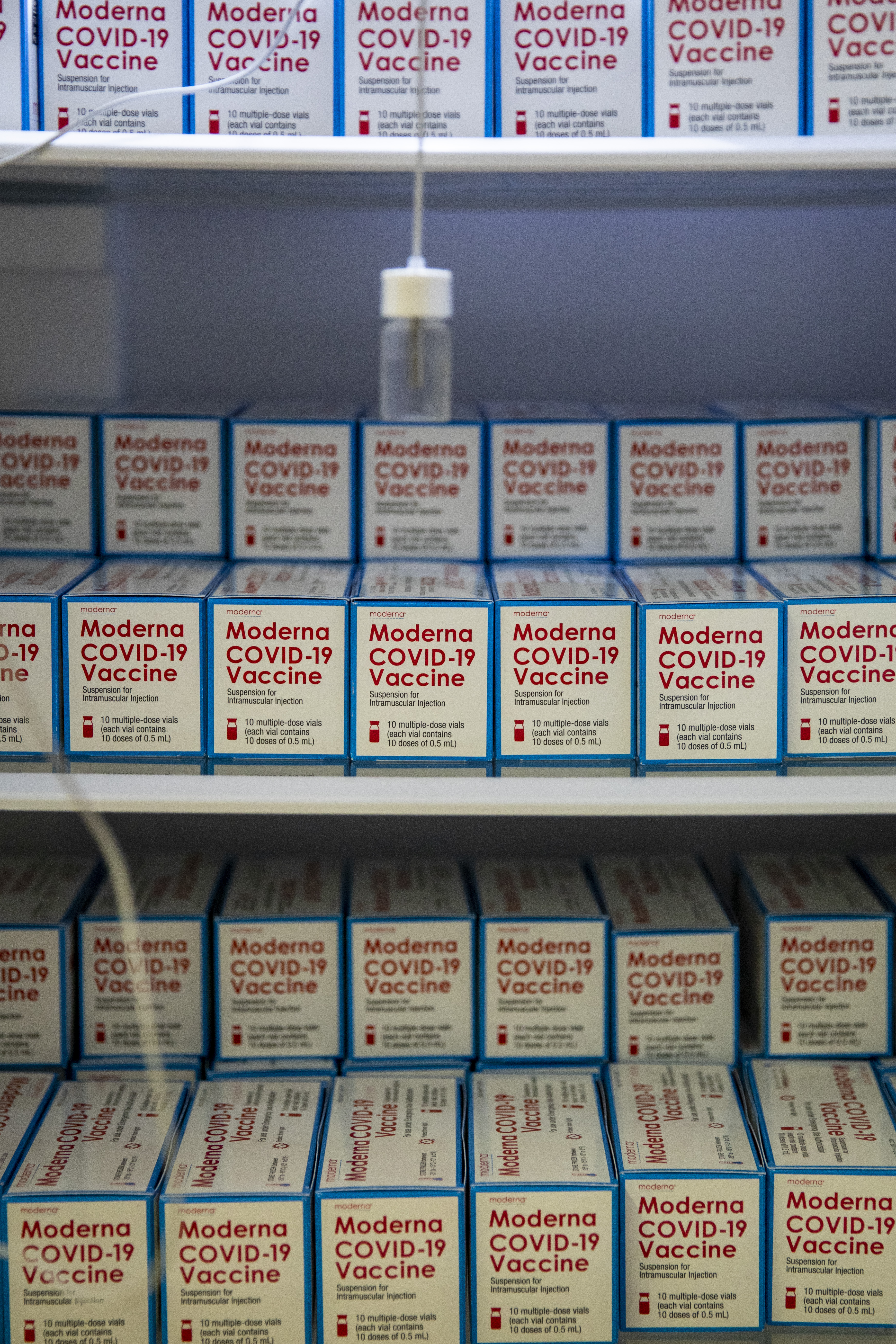 Boxes of the Moderna COVID-19 vaccine sitting in freezers...