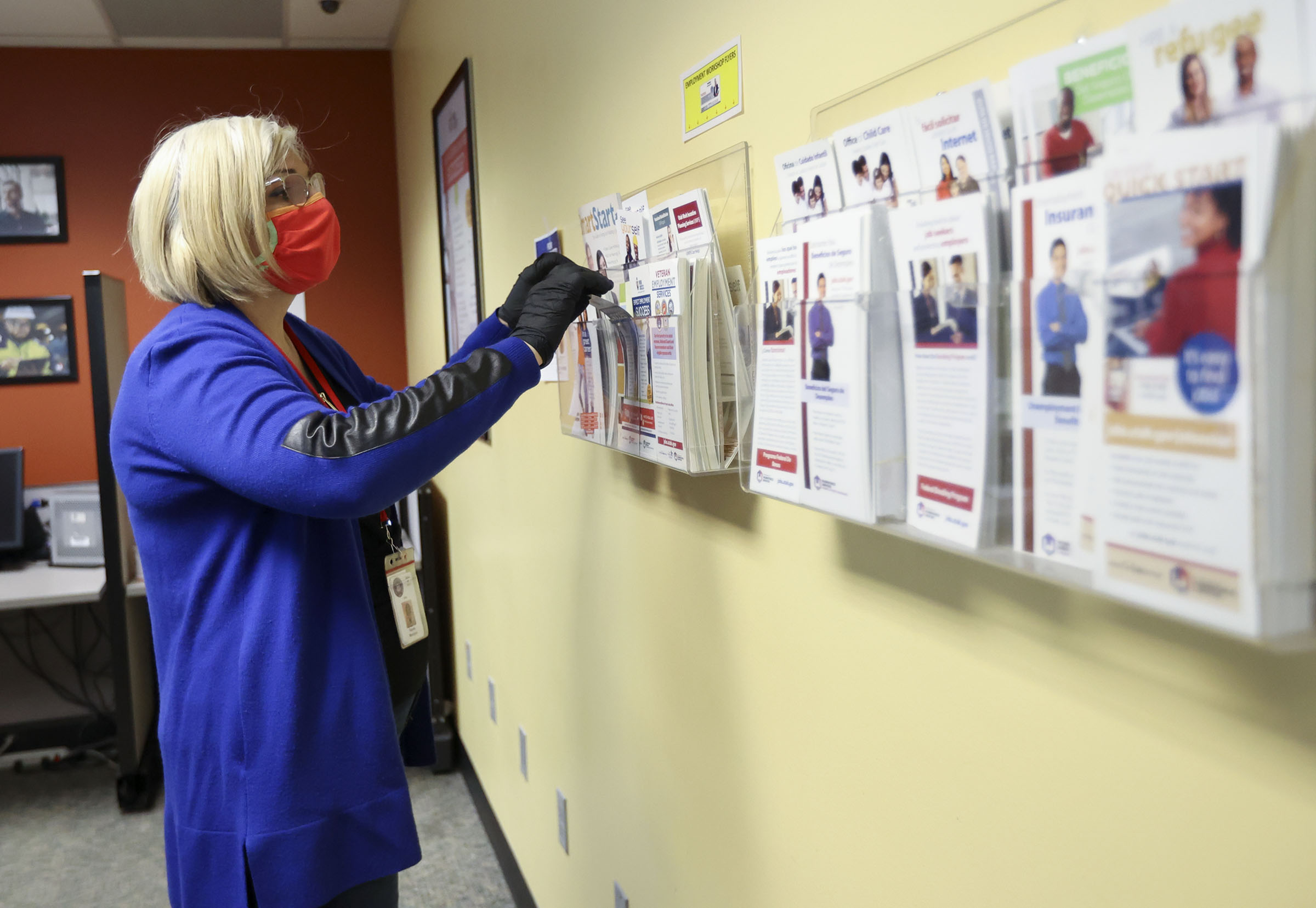 Gayane Manukyan, Department of Workforce Services employment counselor, looks for an unemployment flyer to give a client at the department's office in Salt Lake City.