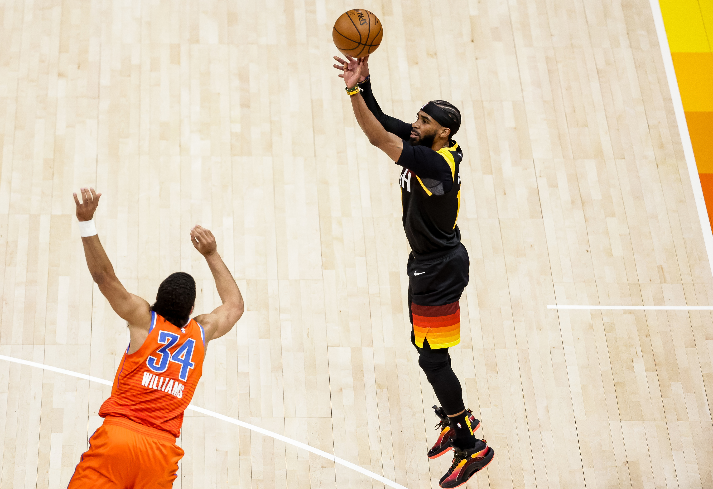 Utah Jazz guard Mike Conley shoots over Oklahoma City Thunder forward Kenrich Williams.