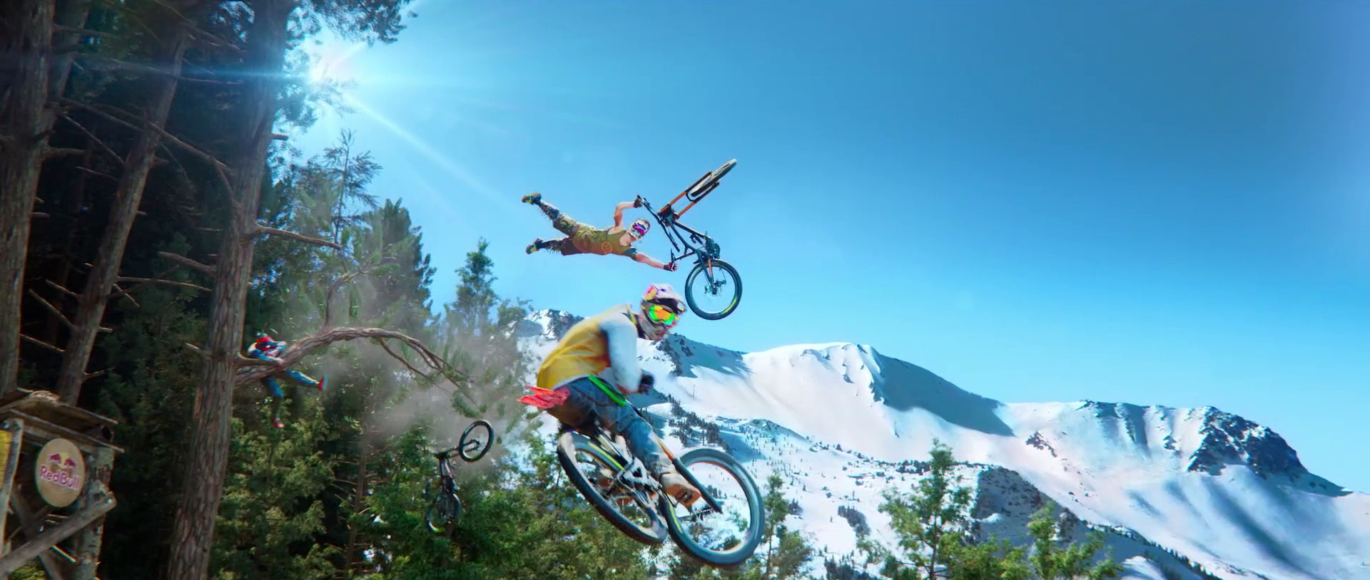 mountain bikers doing tricks off a big jump in Ubisoft's Riders Republic