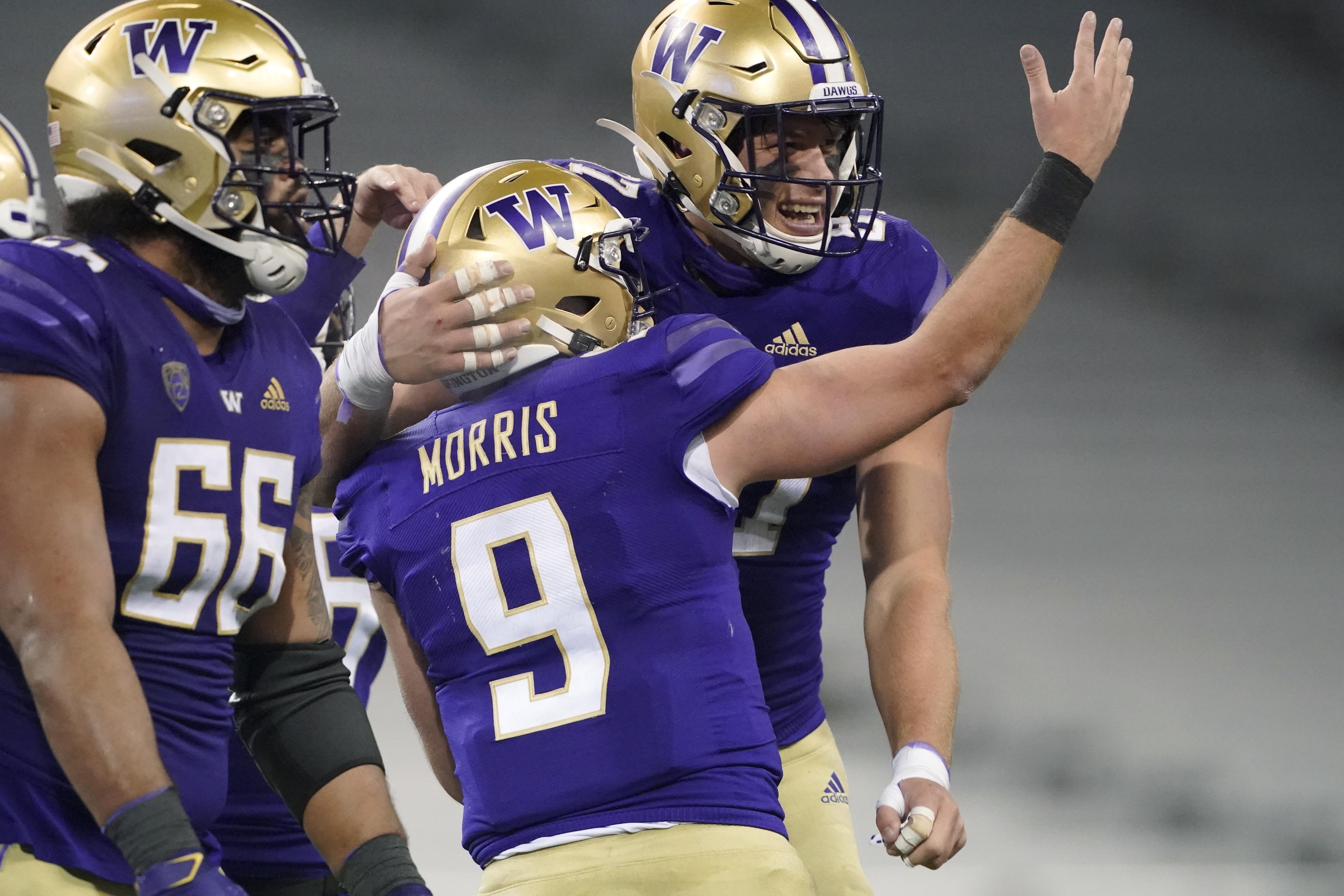 Washington quarterback Dylan Morris celebrates with tight end Cade Otton after an Otton touchdown reception against Utah.