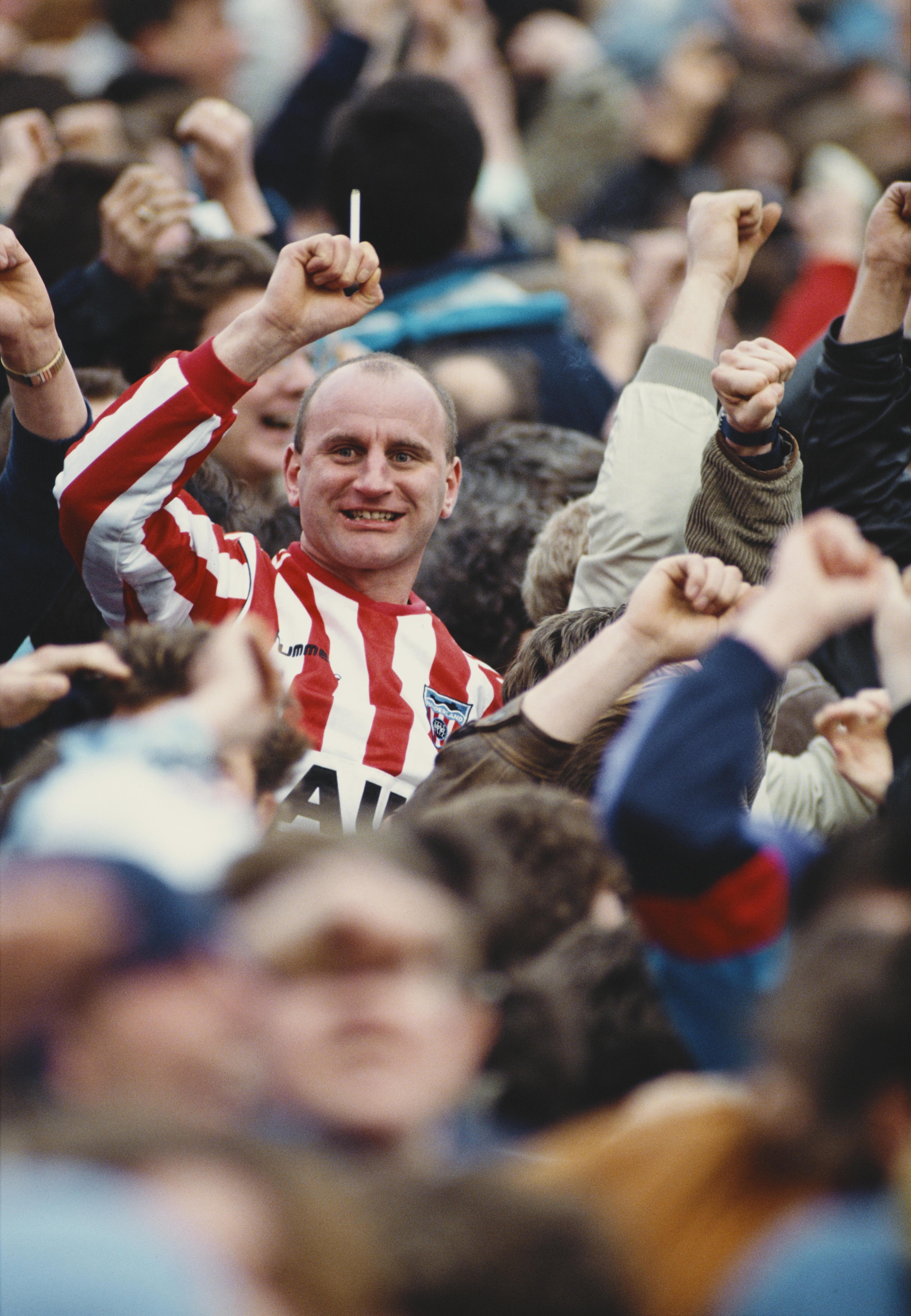 Smoking Sunderland fan celebrates a goal 1990