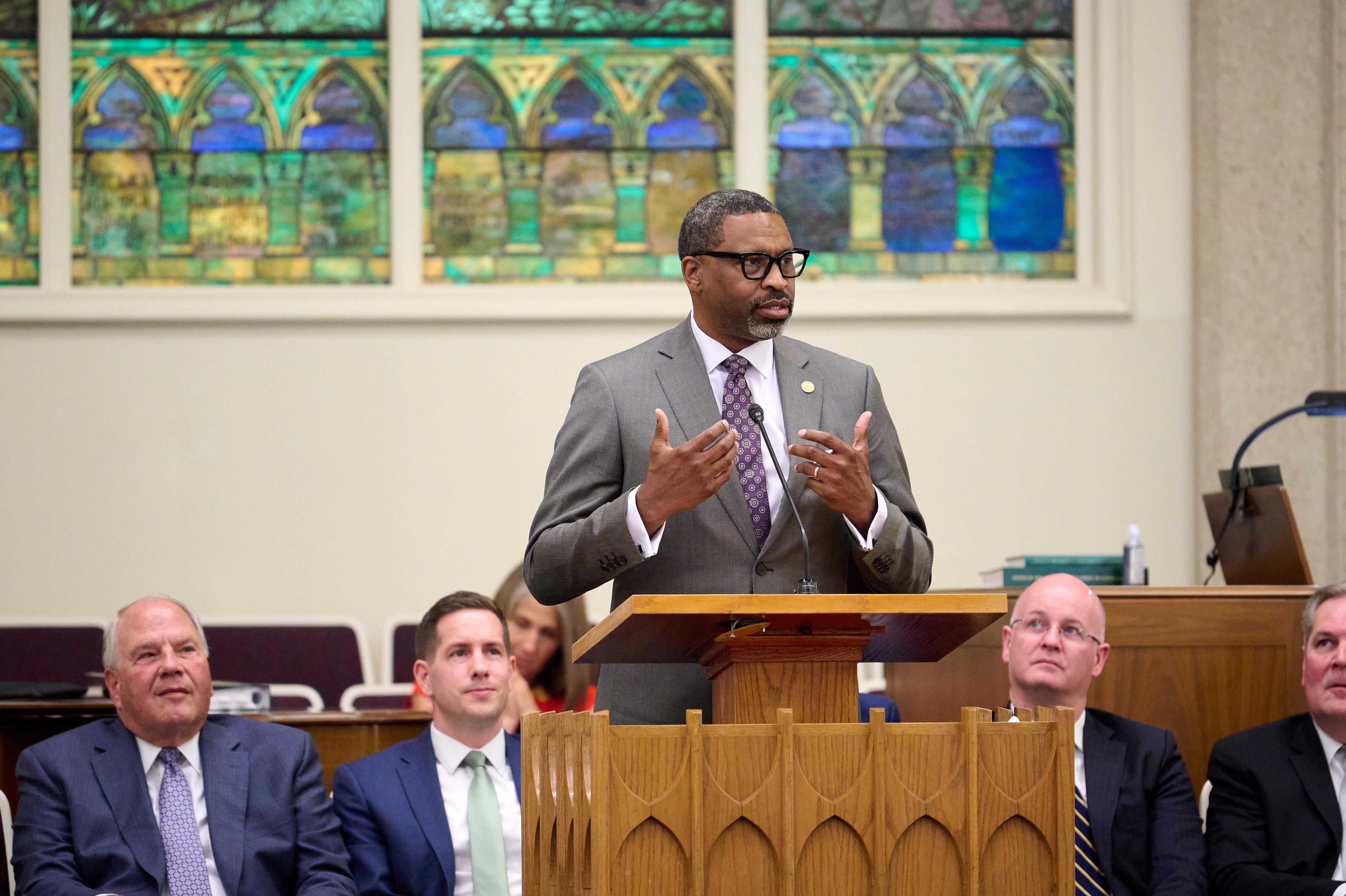NAACP President Derrick Johnson speaks to the Salt Lake City Utah 14th Ward as Elder Ronald A. Rasband listens.