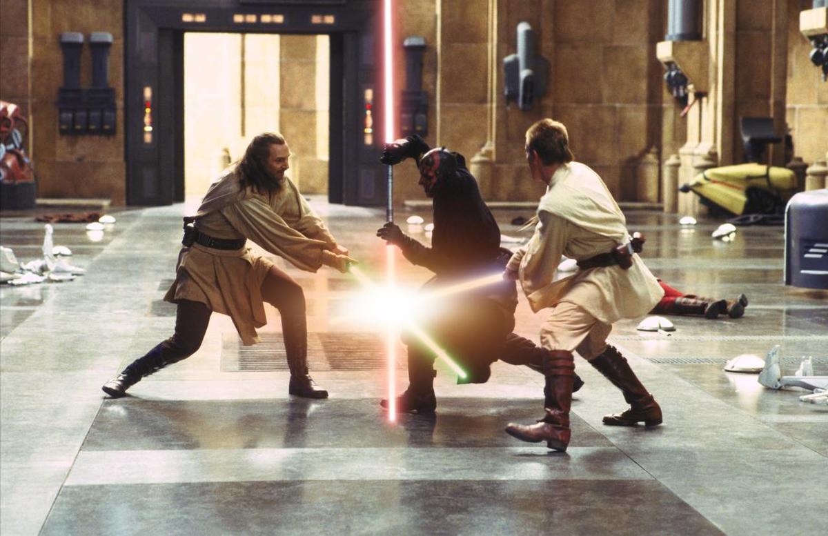 Qui-Gon (Liam Neeson, left) and Obi-Wan (Ewan McGregor) battle Sith Lord Darth Maul.