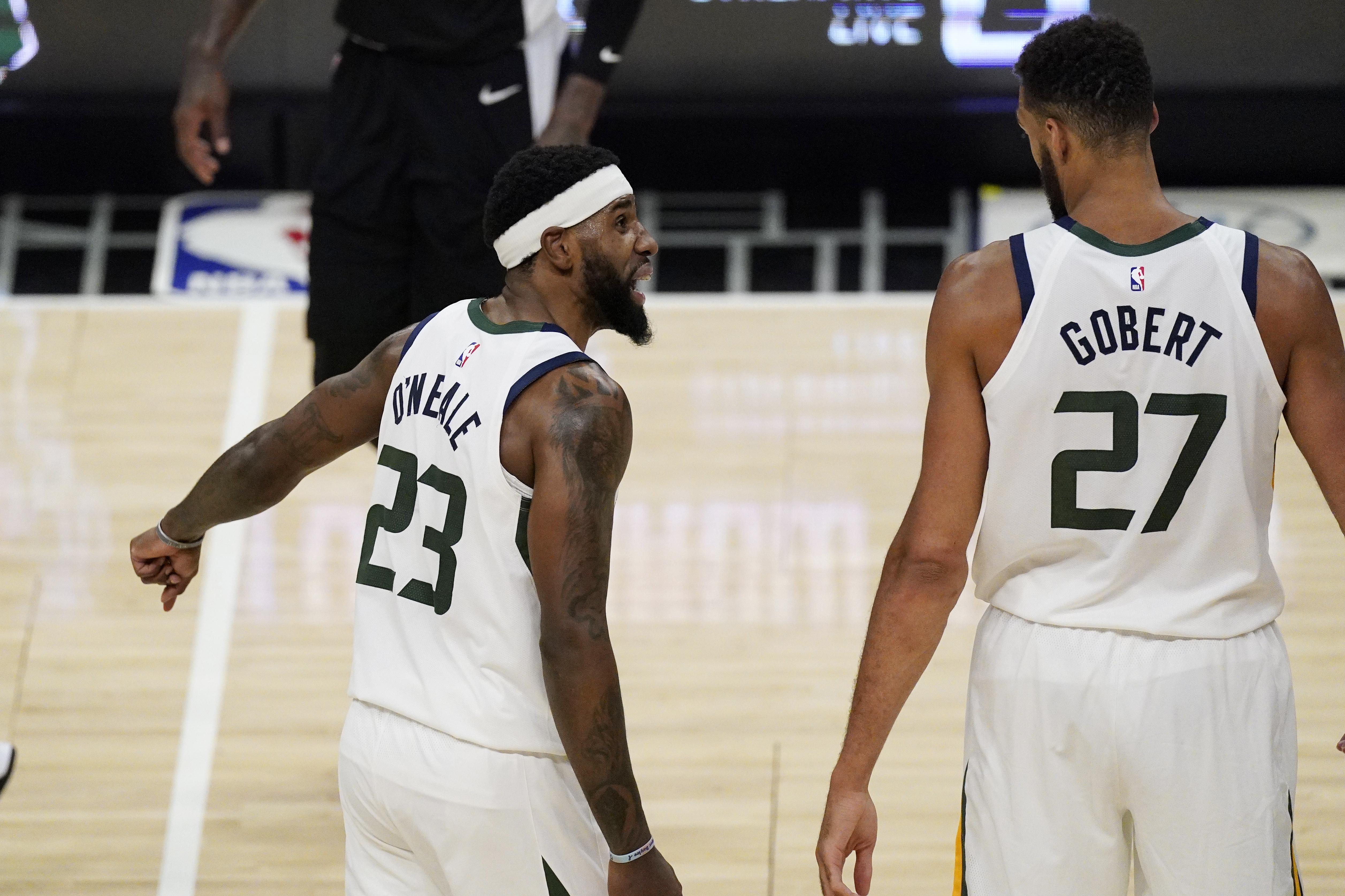 Utah Jazz forward Royce O'Neale, left, exchanges words with center Rudy Gobert.