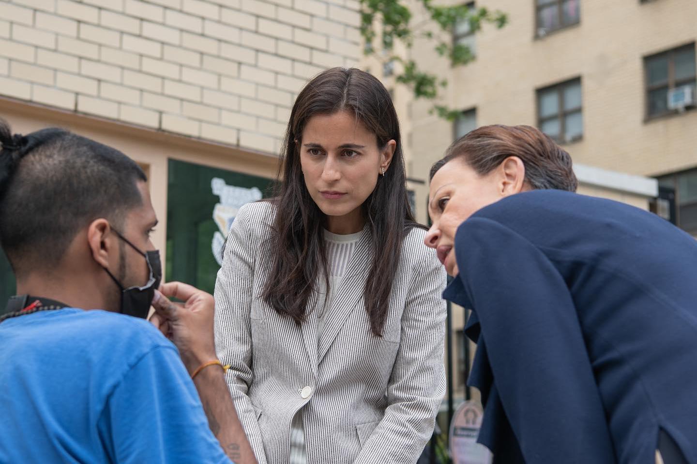 Manhattan district attorney candidate Tali Farhadian Weinstein speaks with a voter, May 28, 2021.