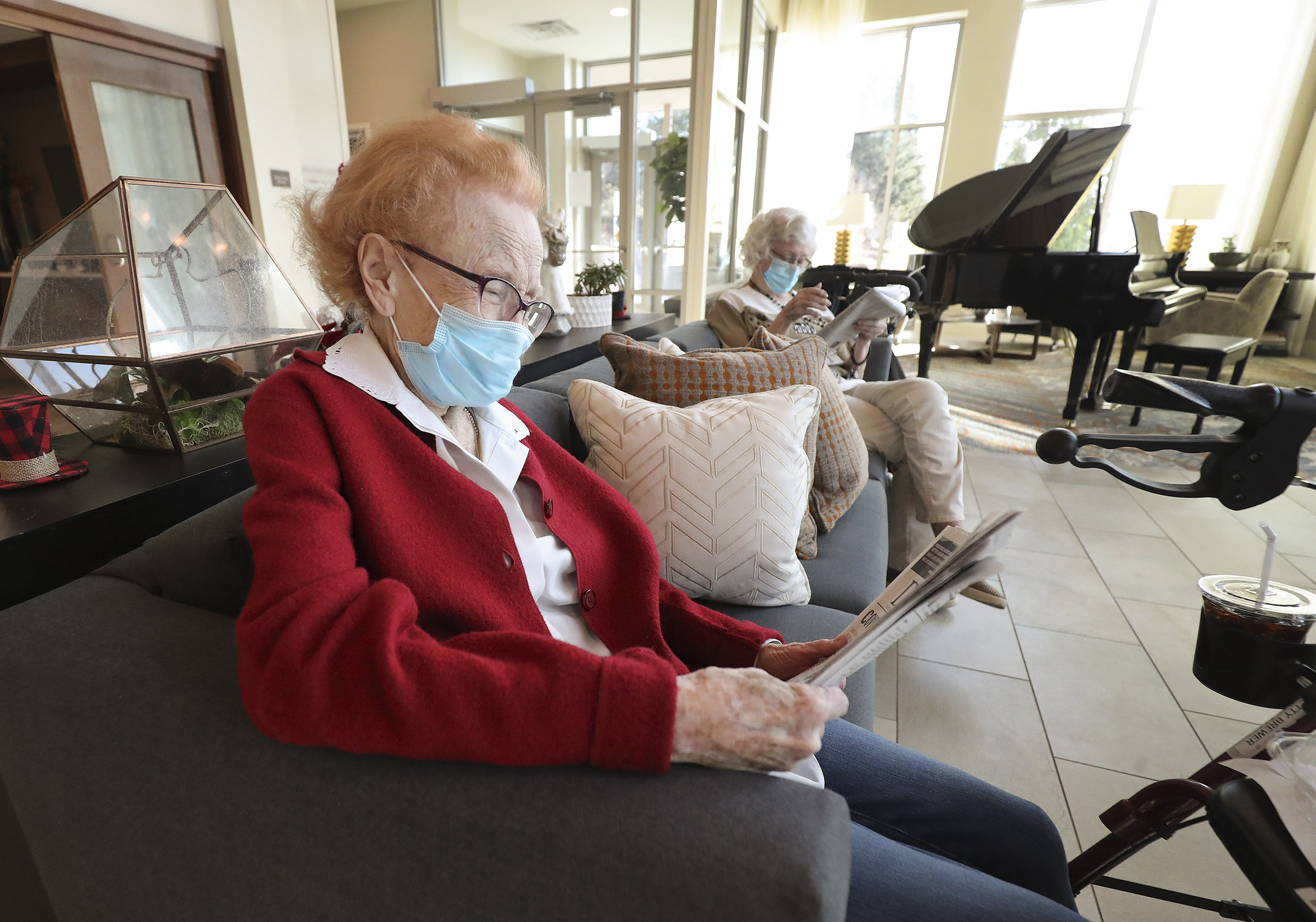 Residents of The Ridge Foothill, read newspapers while socially distanced at the assisted living community in Salt Lake City.
