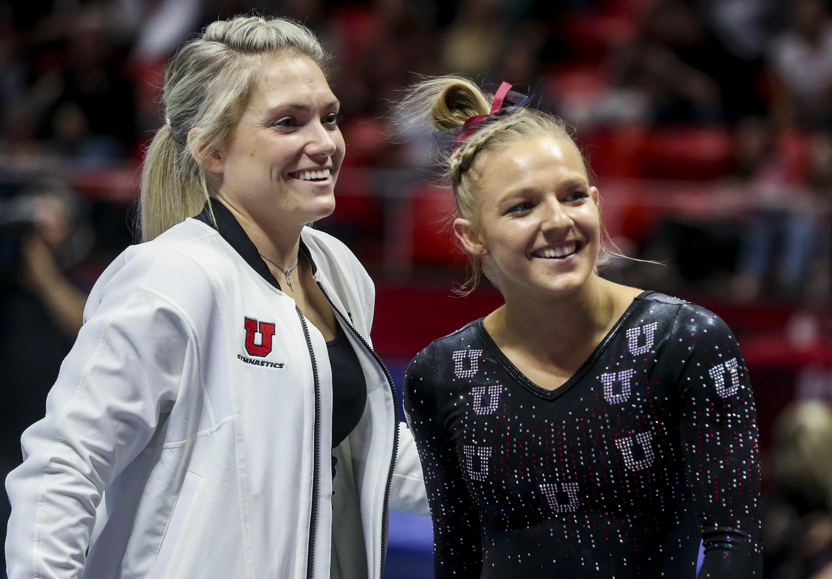 Former Utah assistant coach Courtney McCool Griffeth and gymnast Jillian Hoffman smile after Hoffman's floor peformance.