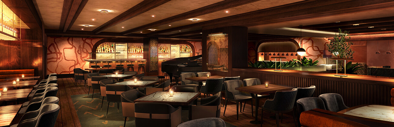 A dark restaurant with paintings on the back wall