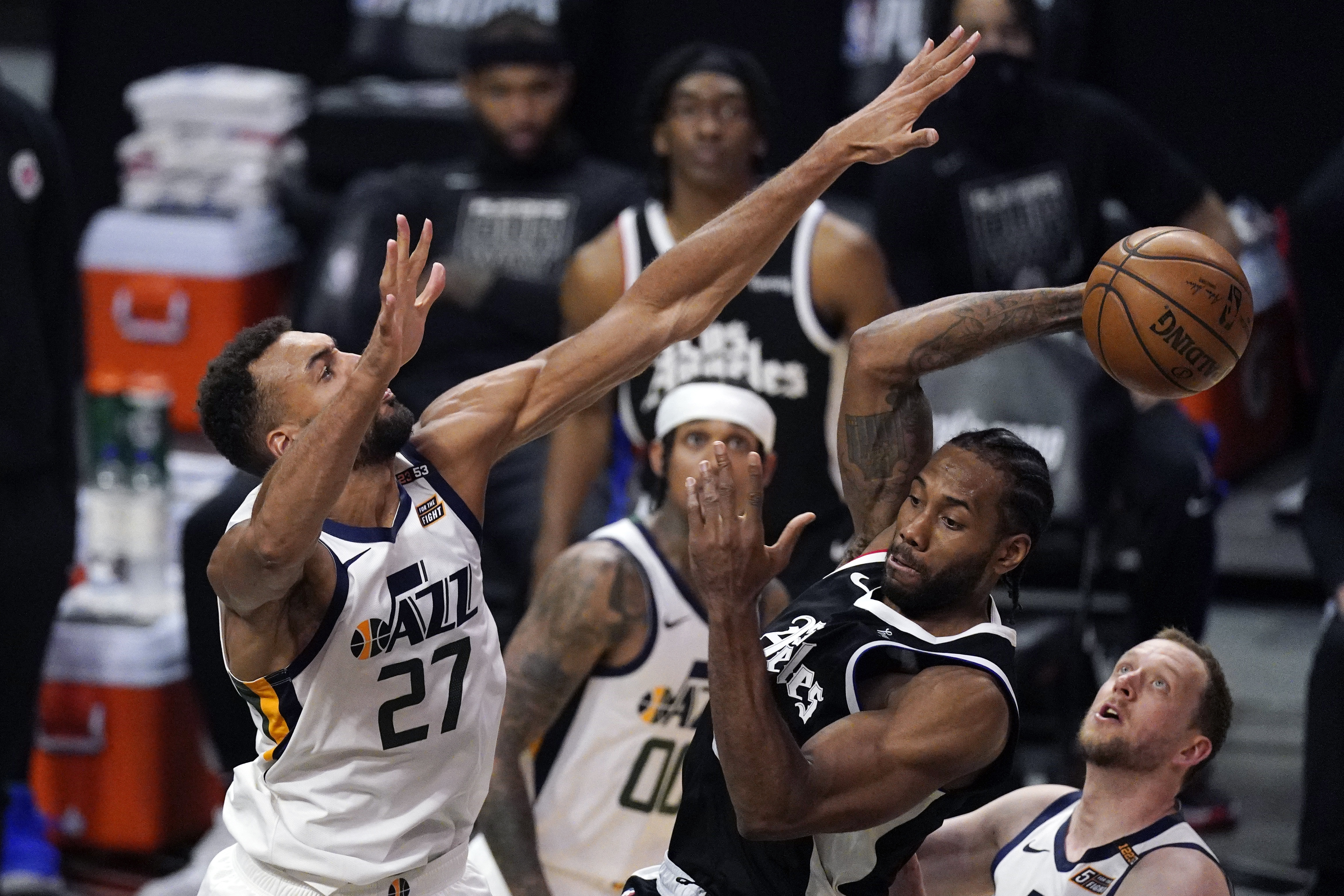Los Angeles Clippers forward Kawhi Leonard passes the ball as Utah Jazz center Rudy Gobert defends in Game 3 of their playoff series.