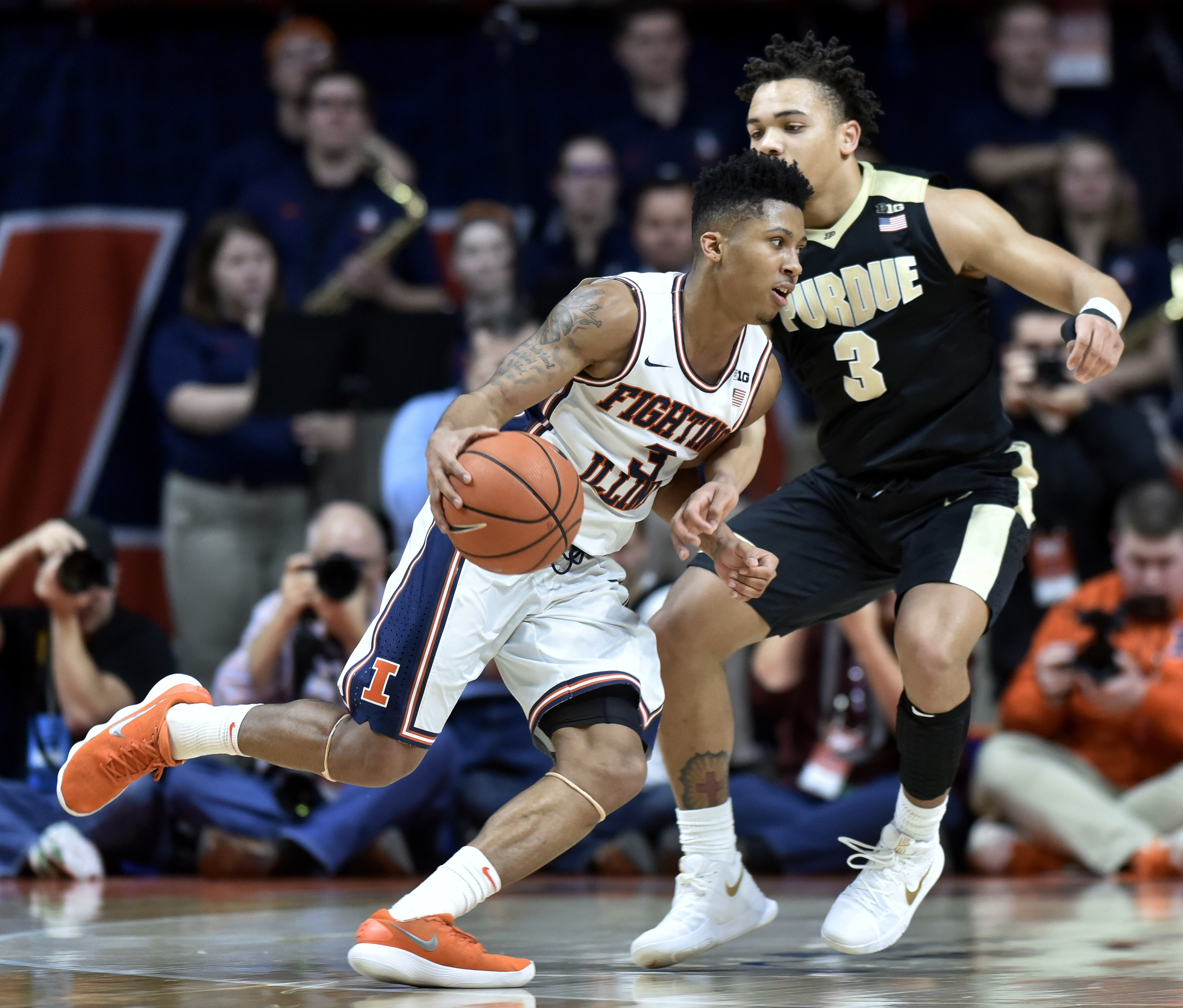 Illinois guard Te'Jon Lucas makes a move against Purdue guard Carsen Edwards. Lucas is transferring to BYU this for the upcoming season.