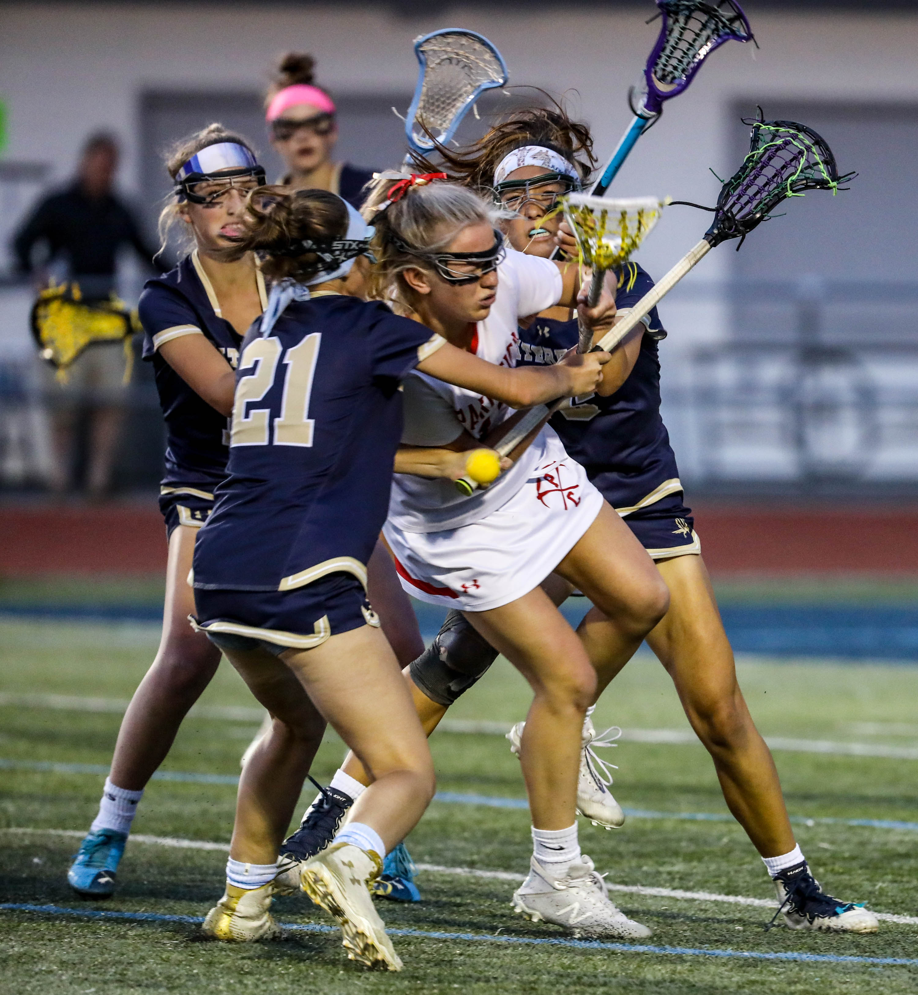 The Waterford Ravens face off against the Park City Miners during the Division A girls lacrosse championship game at Layton High School in Layton on Friday, May 28, 2021.