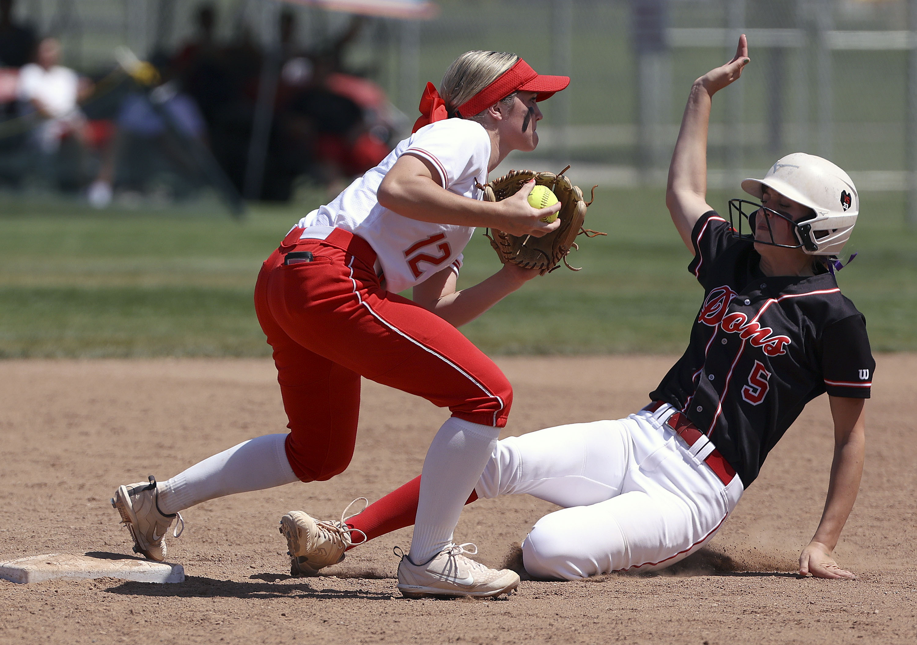 Spanish Fork plays Mountain Ridge's Tessa Hokanson gets Spanish Fork's Avery Sapp out at second base during the 5A championship softball game at Spanish Fork Sports Park in Spanish Fork on Friday, May 28, 2021. Spanish Fork won 13-2.