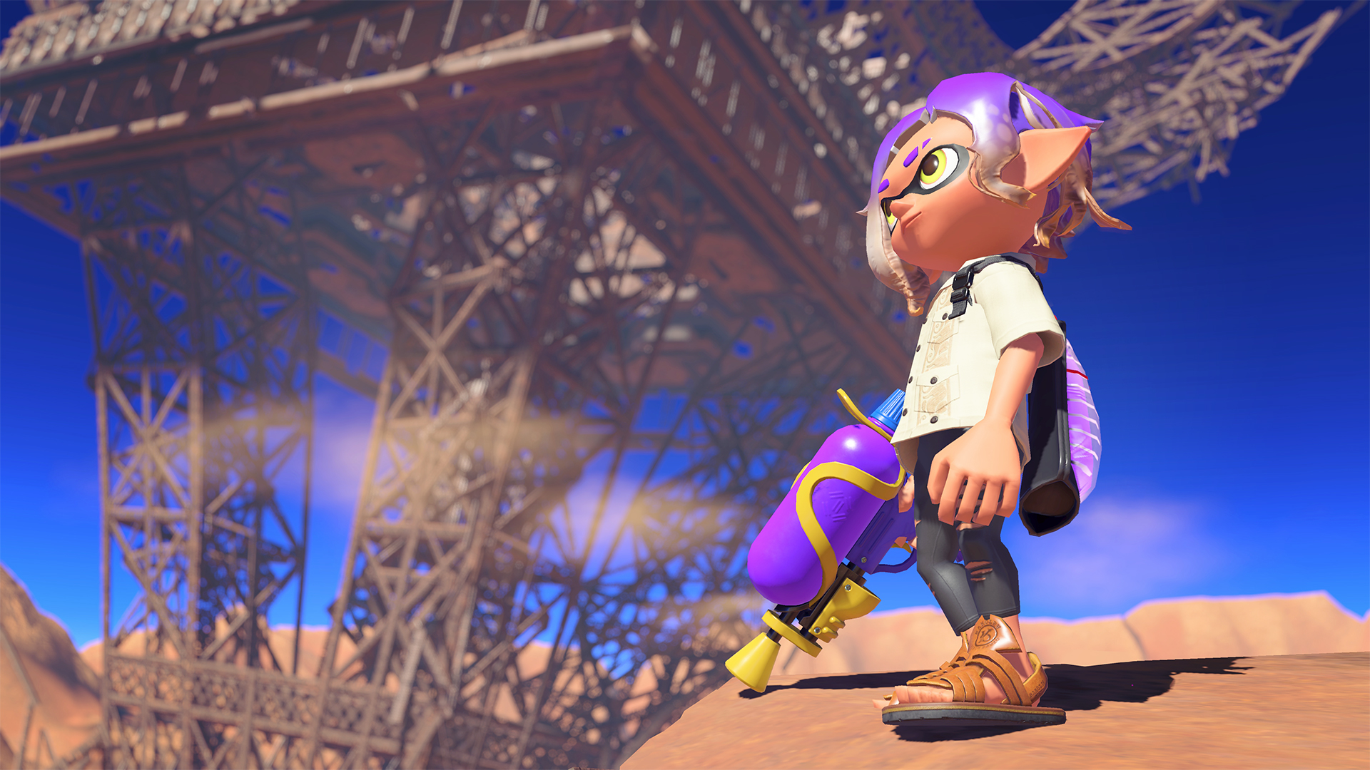 an inkling with purple hair and ink gun surveys a post-apocalyptic wasteland.