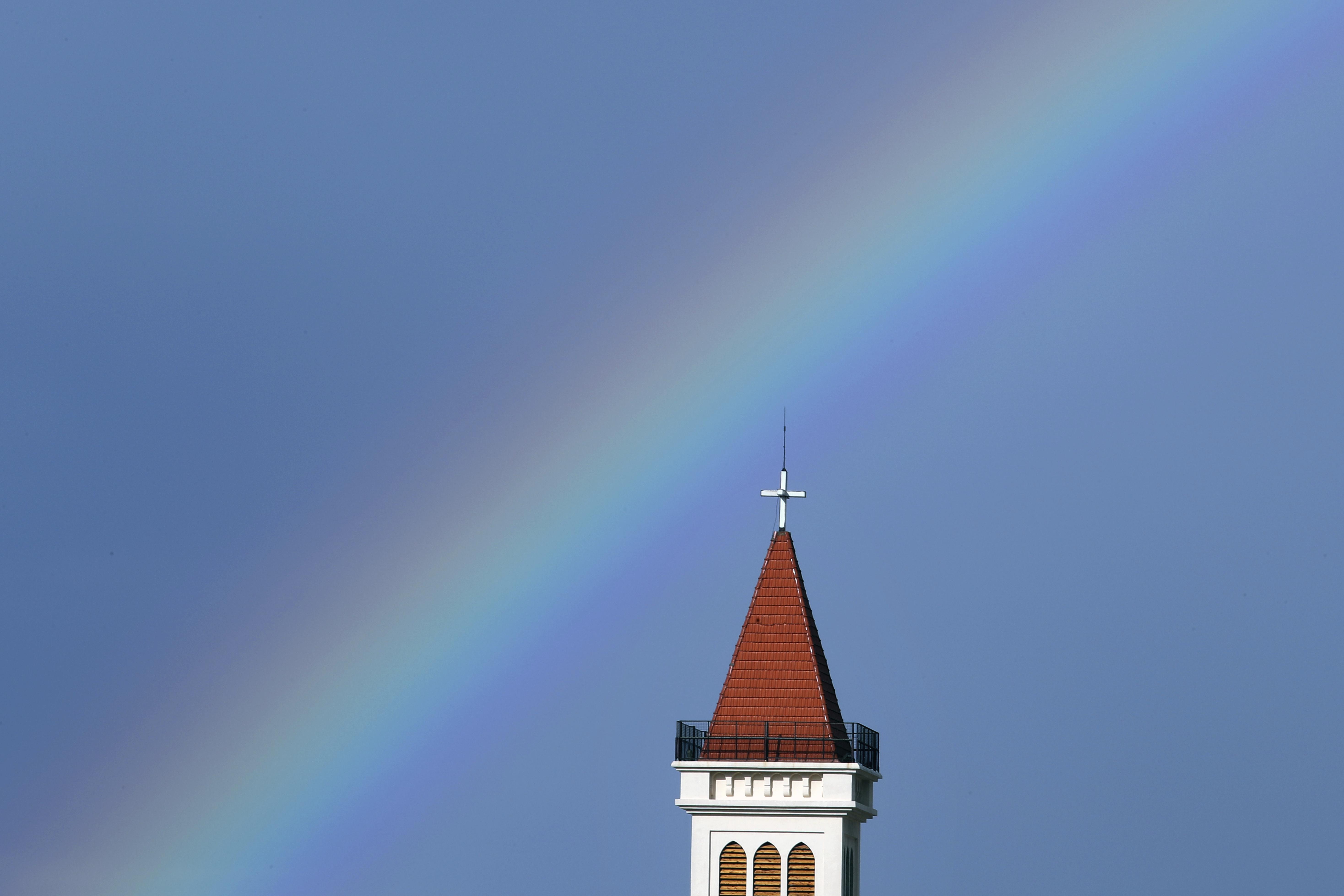 A rainbow arcs over a church in Beirut, Lebanon.