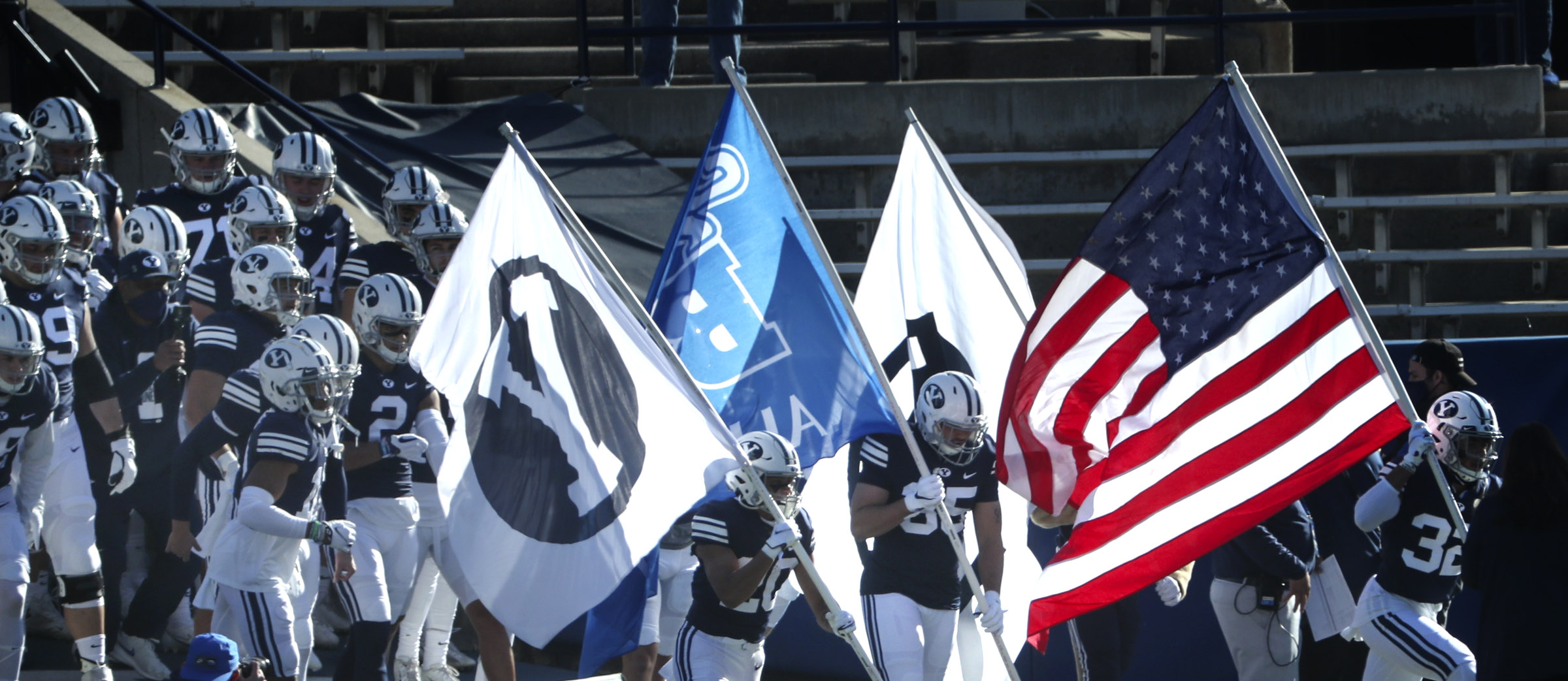 BYU football players take the field before a game against North Alabama in 2020.
