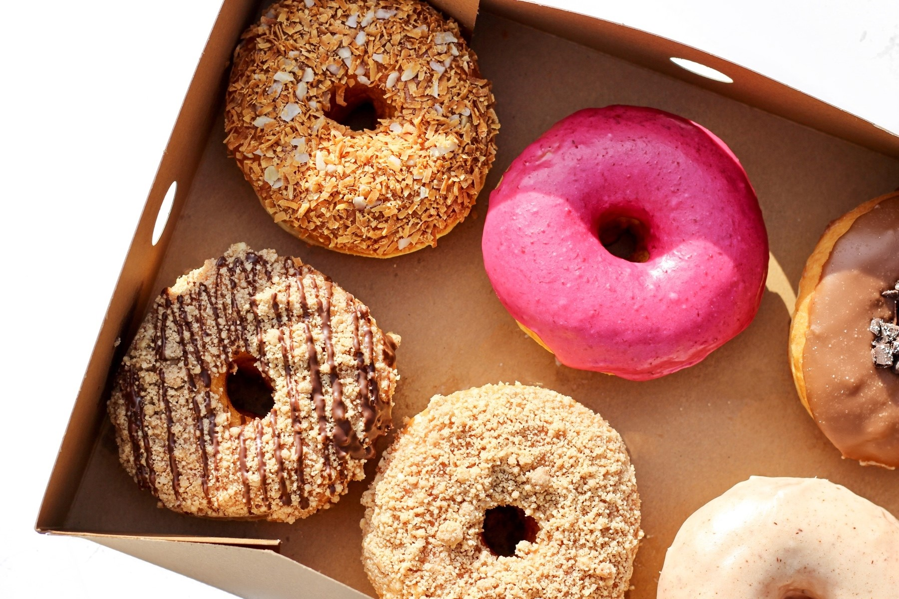 Box of assorted doughnuts from Barrio Dona's