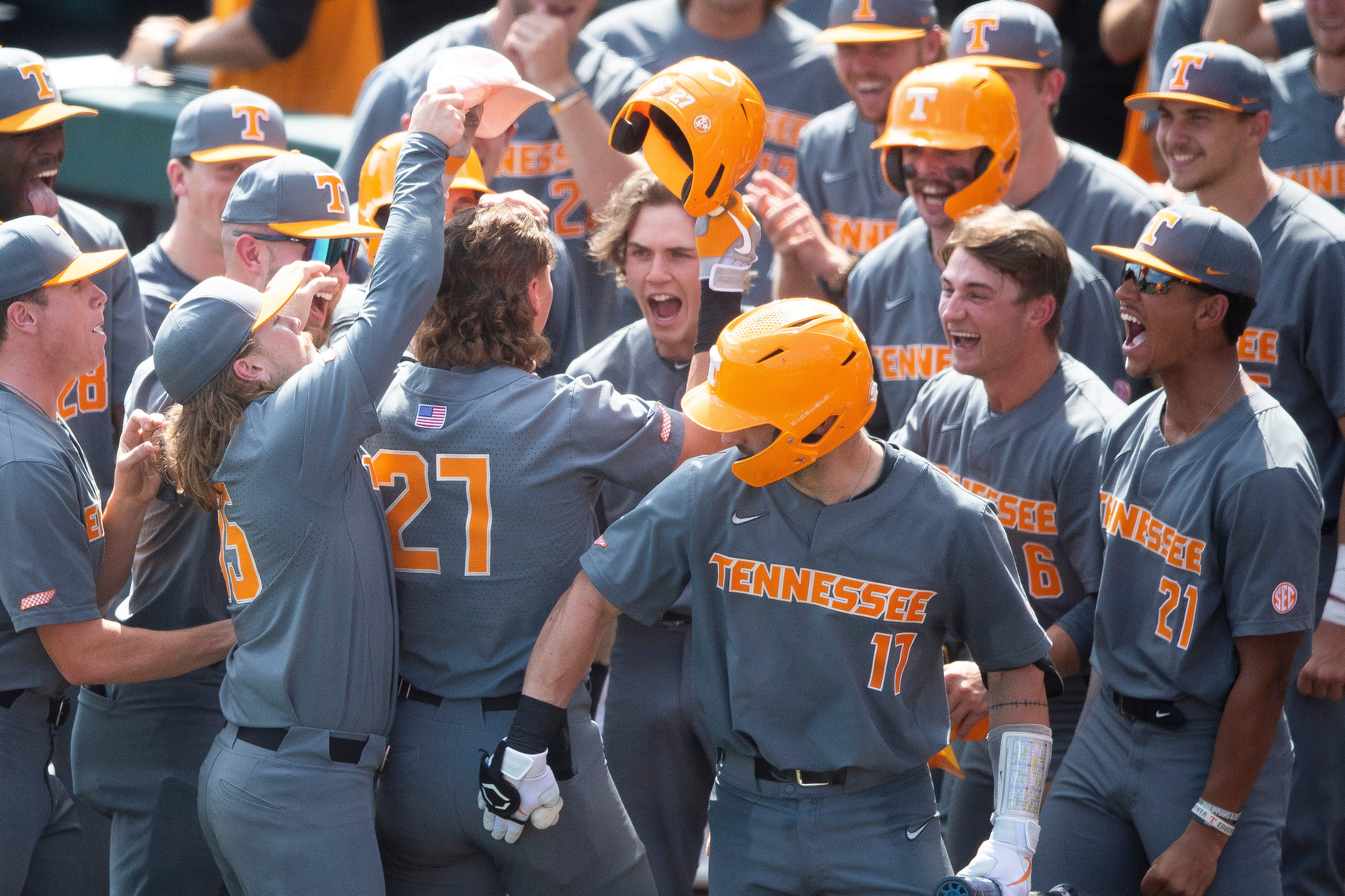 The Tennessee bench gives Tennessee's Jordan Beck the Daddy hat during game two of the Knoxville Super Regional between the Tennessee Volunteers and the LSU Tigers held at Lindsey Nelson Stadium on Sunday, June 13, 2021.