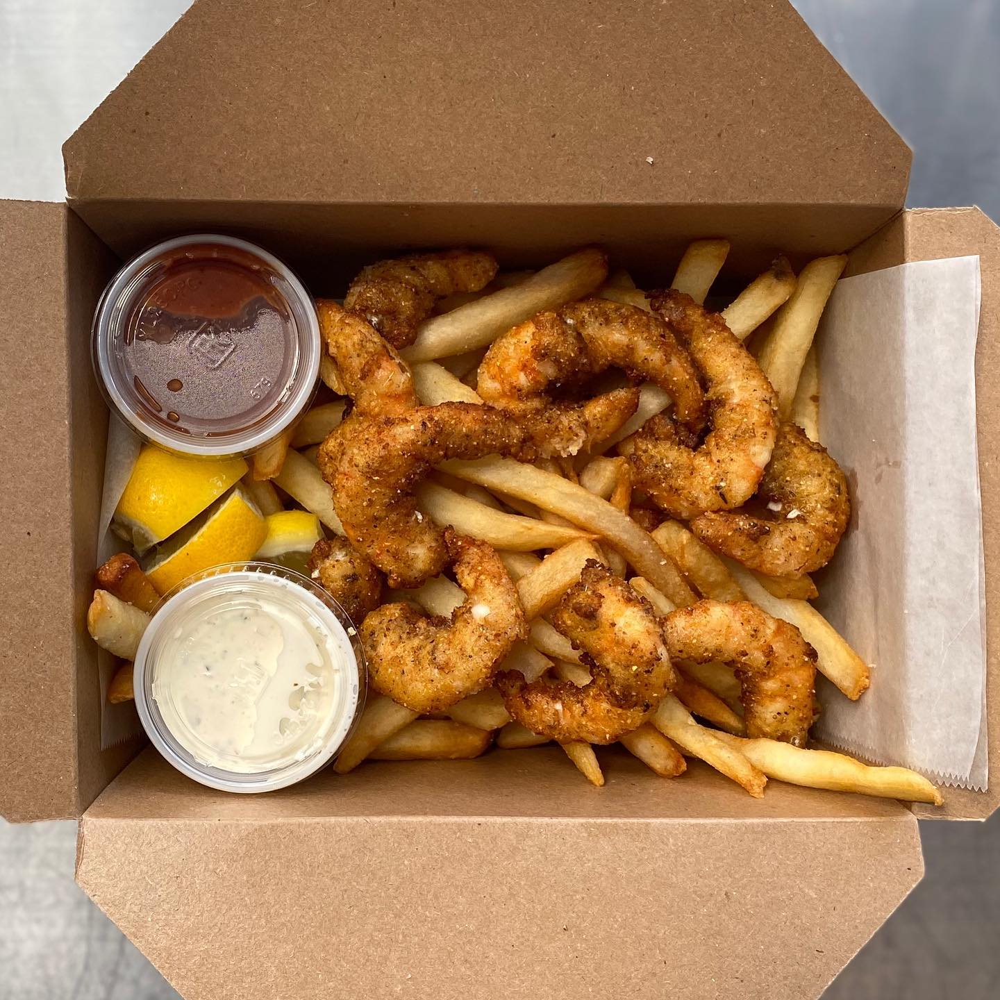 Fried shrimp and fries from Huckleberry