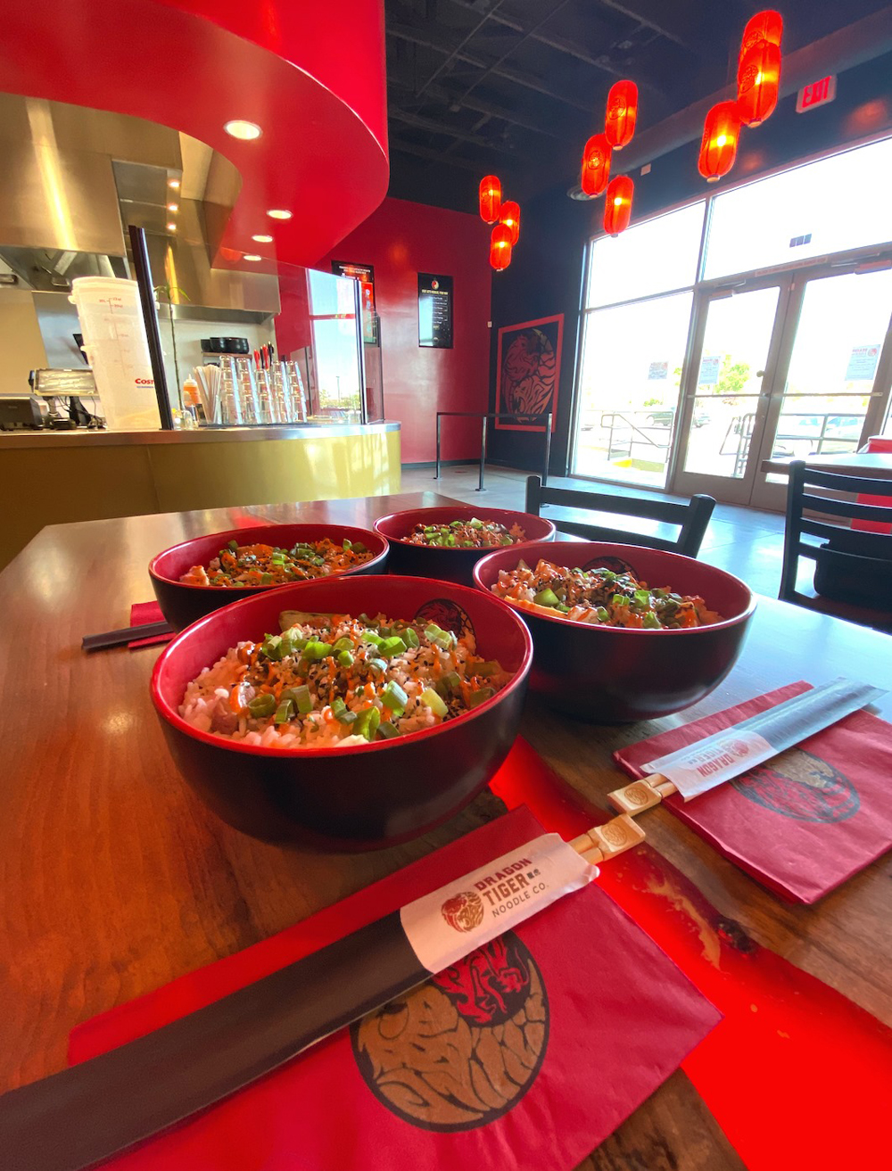 A collection of rice bowls, on the build-it-your-way menu at Dragon Tiger Noodle Co.