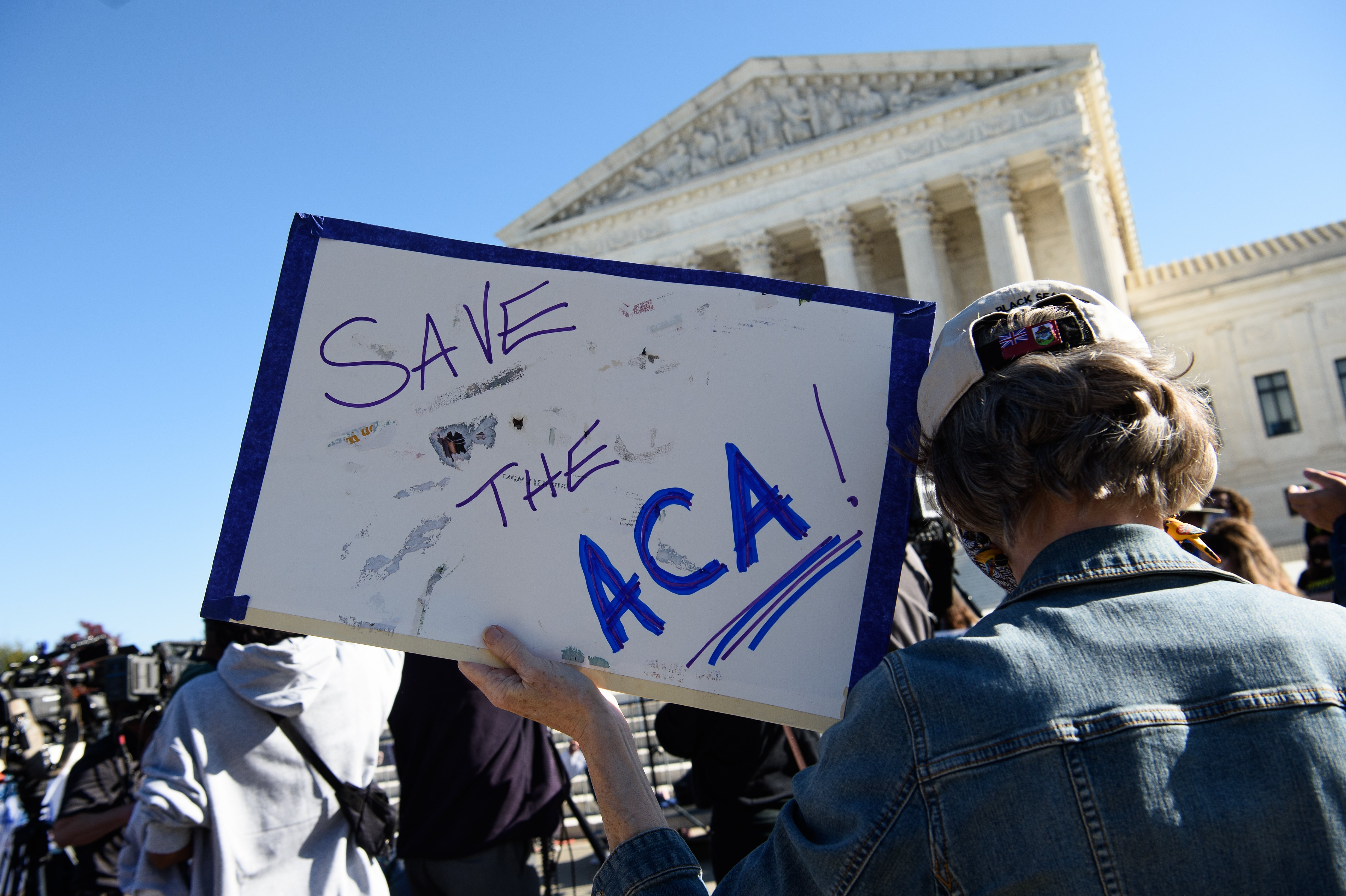"""Sign saying """"save the ACA"""" in front of Supreme Court"""