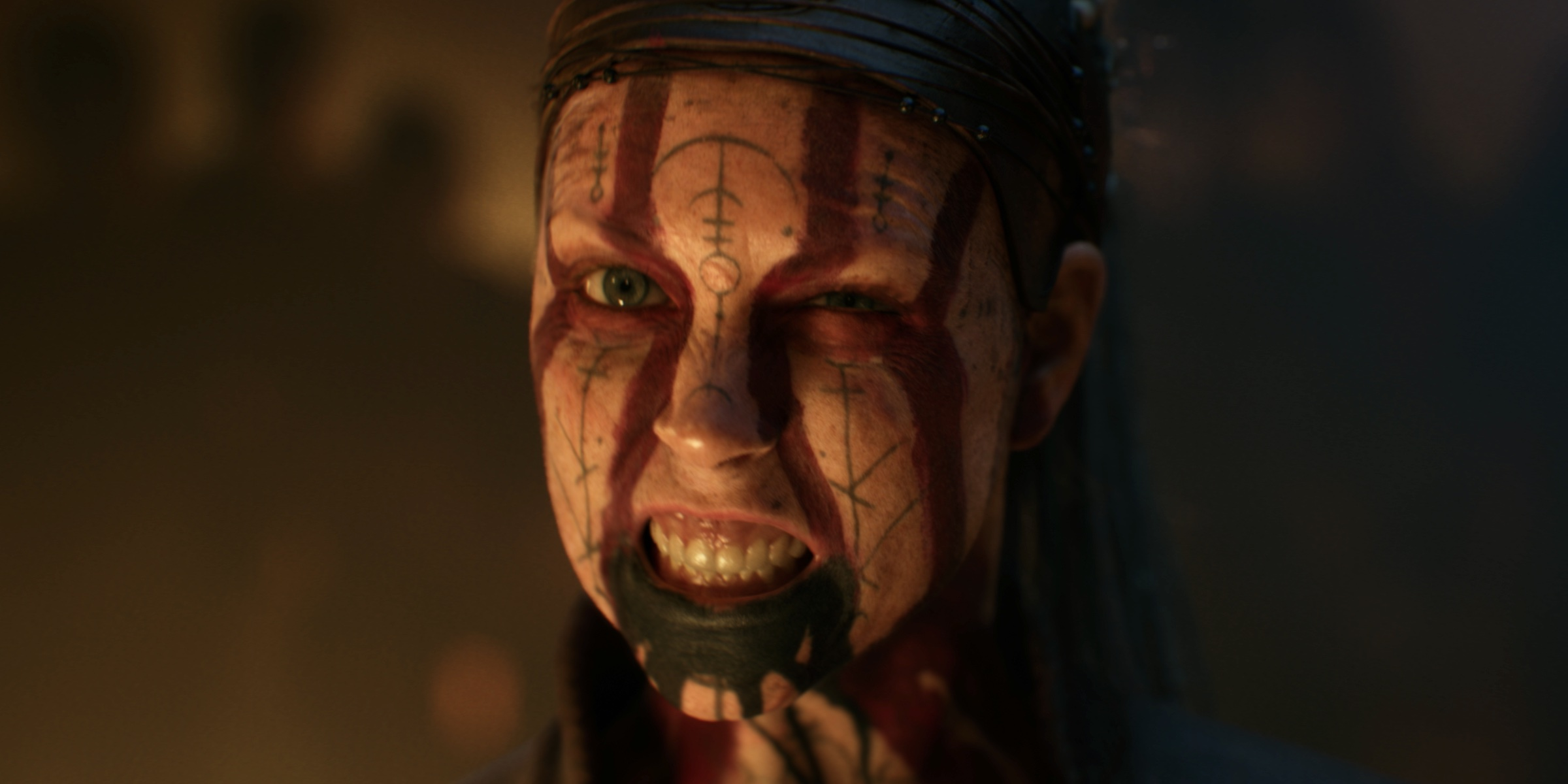 Senua gives a growl in a still from Senua's Saga: Hellblade 2's debut cinematic trailer