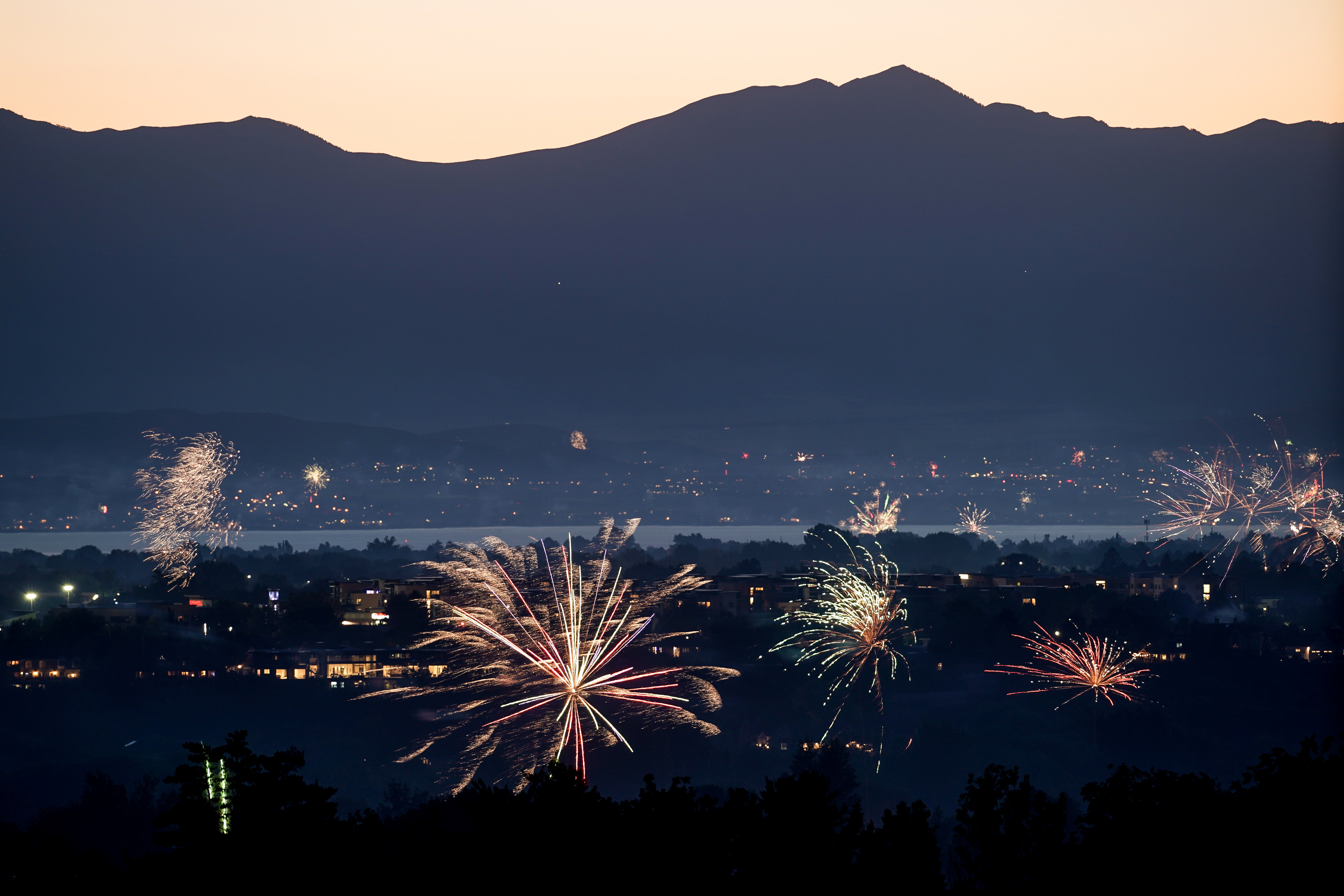 Amateur fireworks are seen from Rock Canyon Park in Provo on Saturday, July 4, 2020.