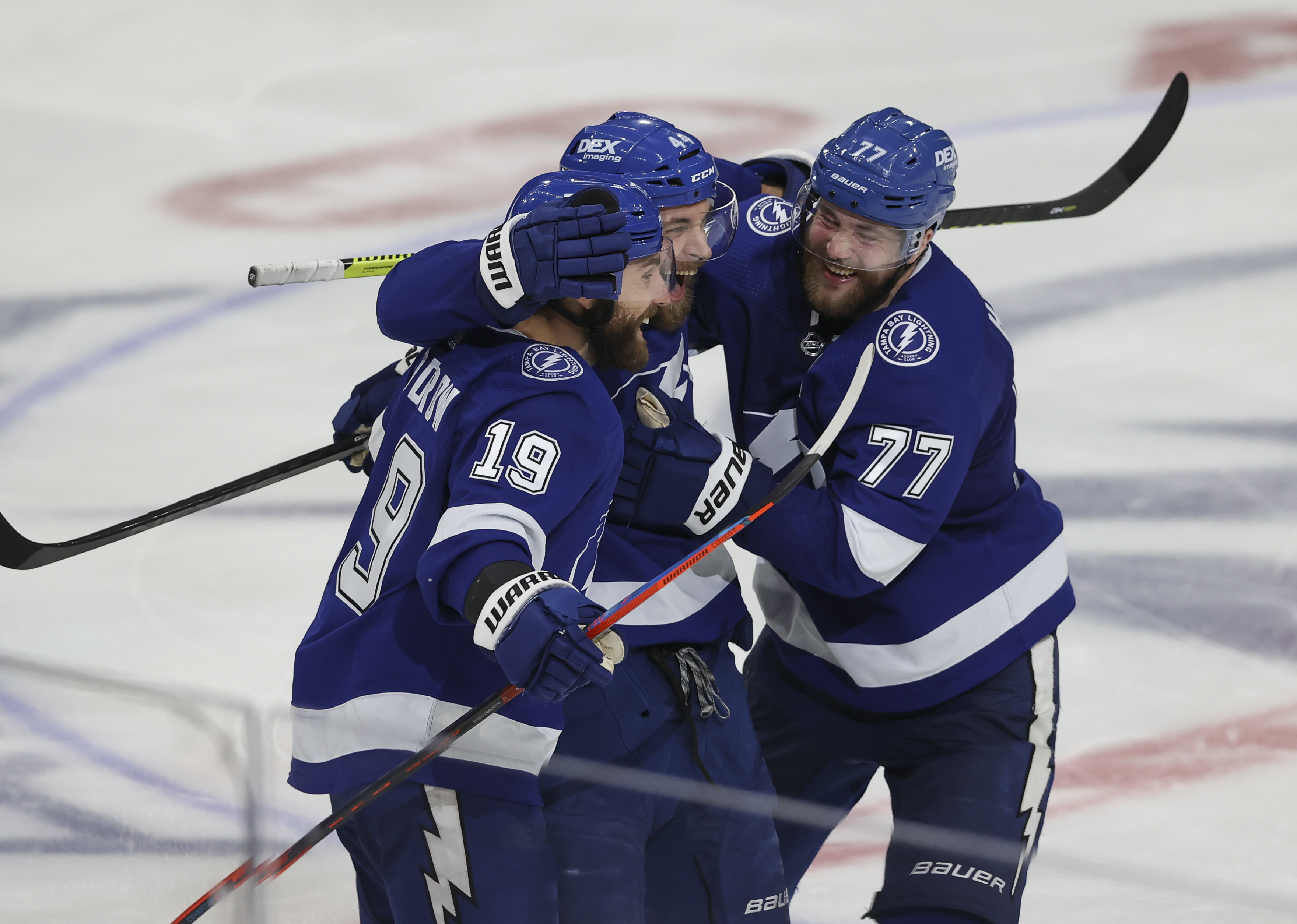 Tampa Bay Lightning defenseman Jan Rutta (44) celebrates with Tampa Bay Lightning right wing Barclay Goodrow (19) and Tampa Bay Lightning defenseman Victor Hedman (77) after scoring a goal in the third period of Game 2 of the Stanley Cup Playoffs Semifinals between the New York Islanders and Tampa Bay Lightning on June 15, 2021 at Amalie Arena in Tampa, FL.