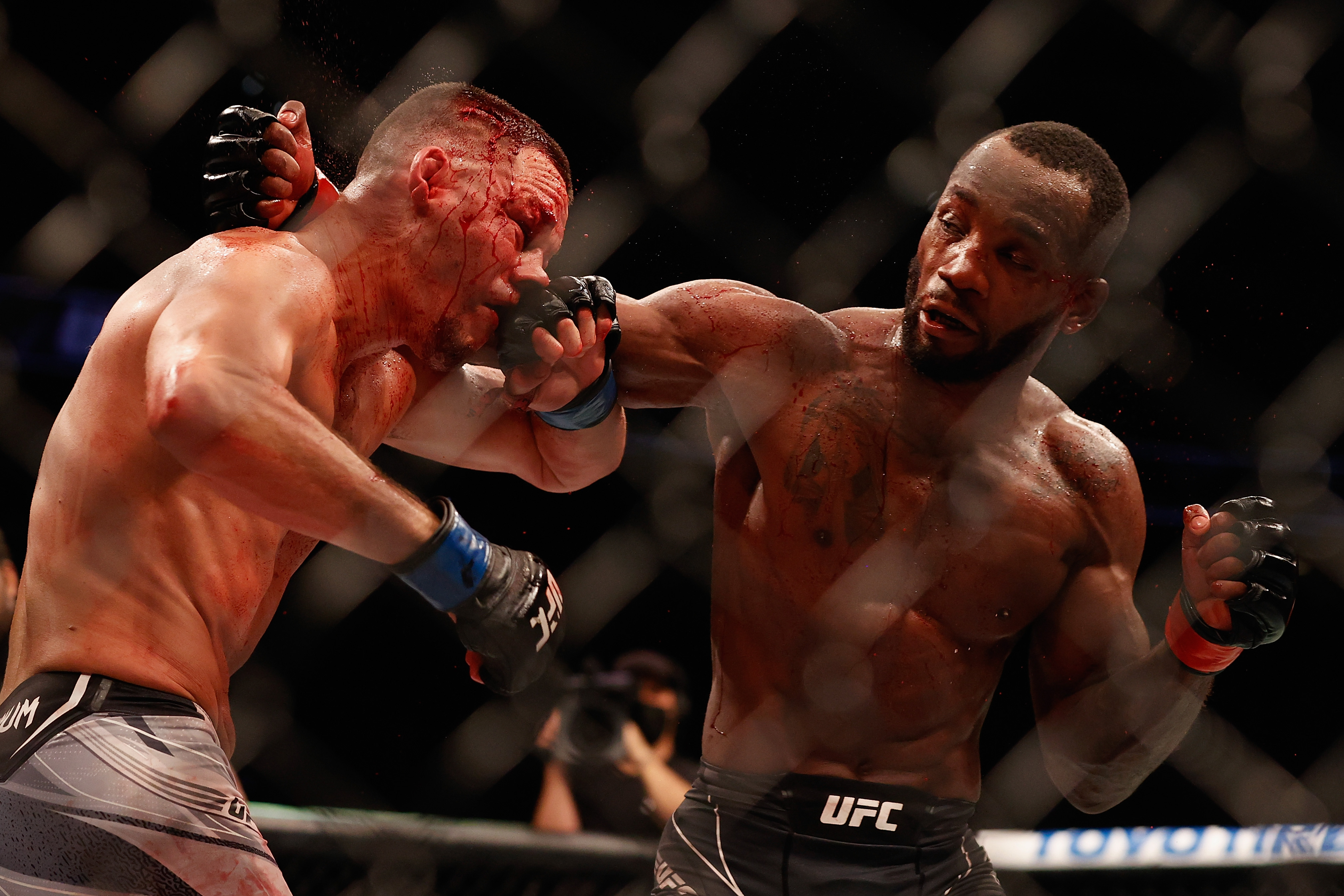 Leon Edwards strikes Nate Diaz in their fight at UFC 263